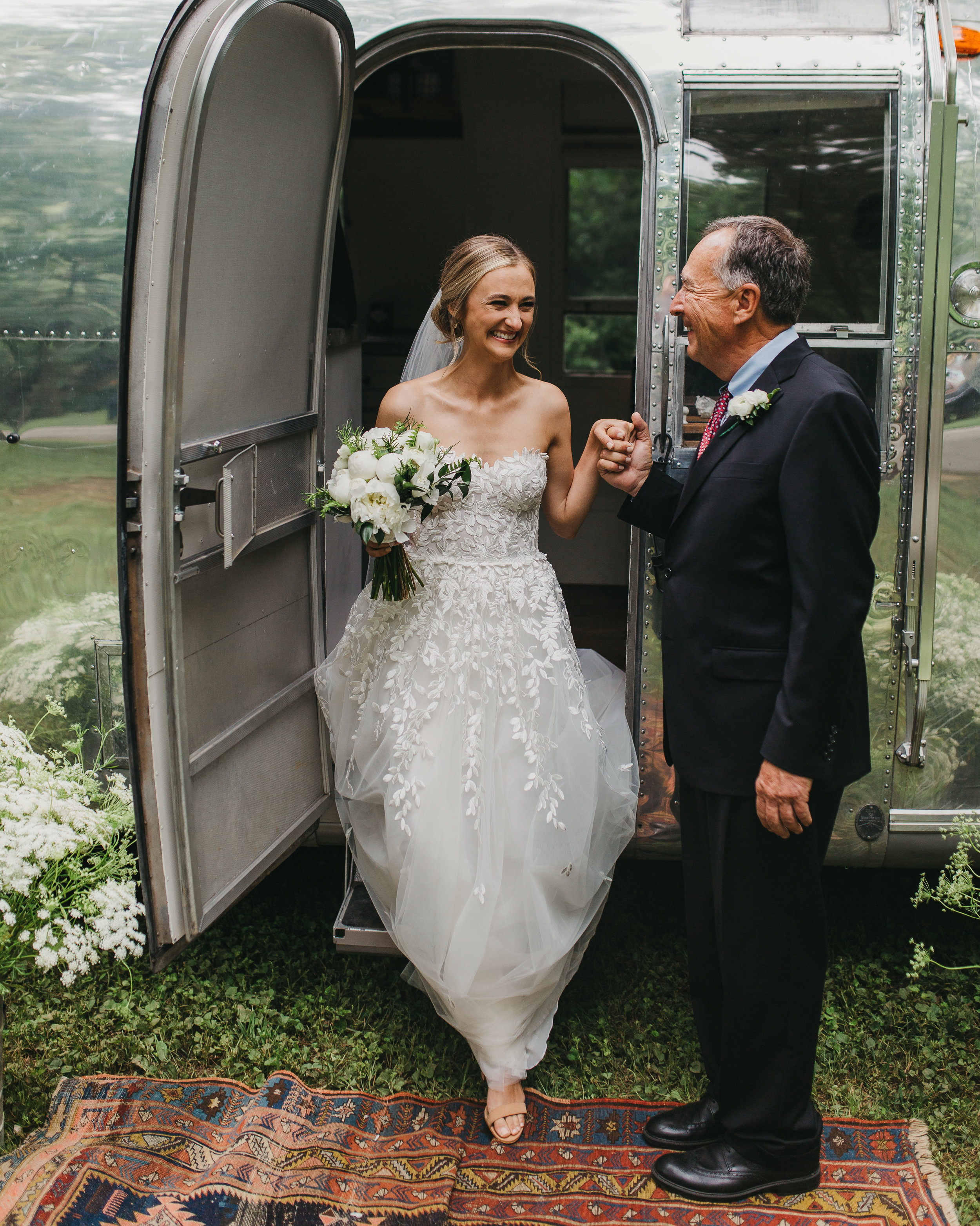 bridal processional from airstream camper on wedding day