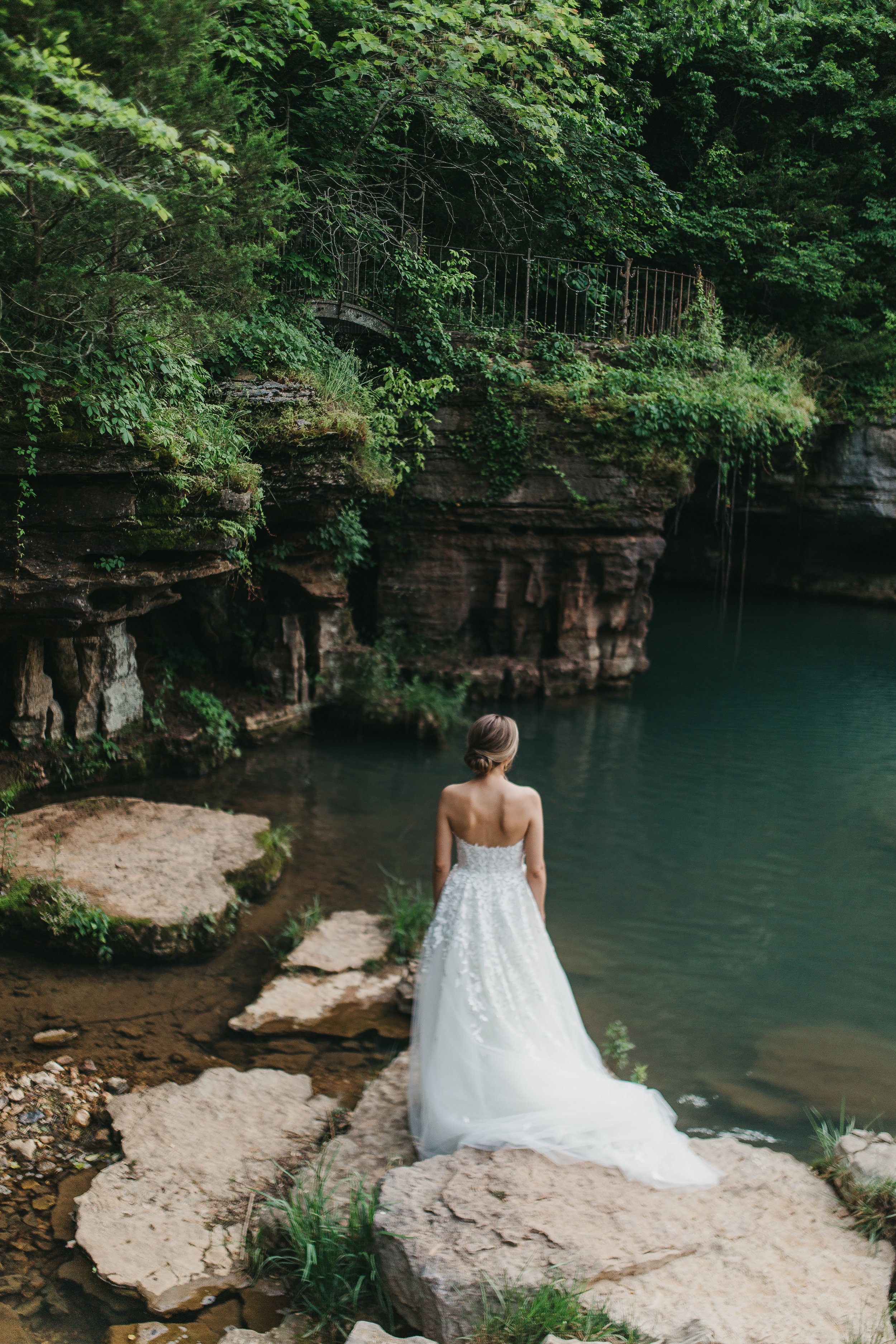 bridal portrait in riverbed of dogwood canyon