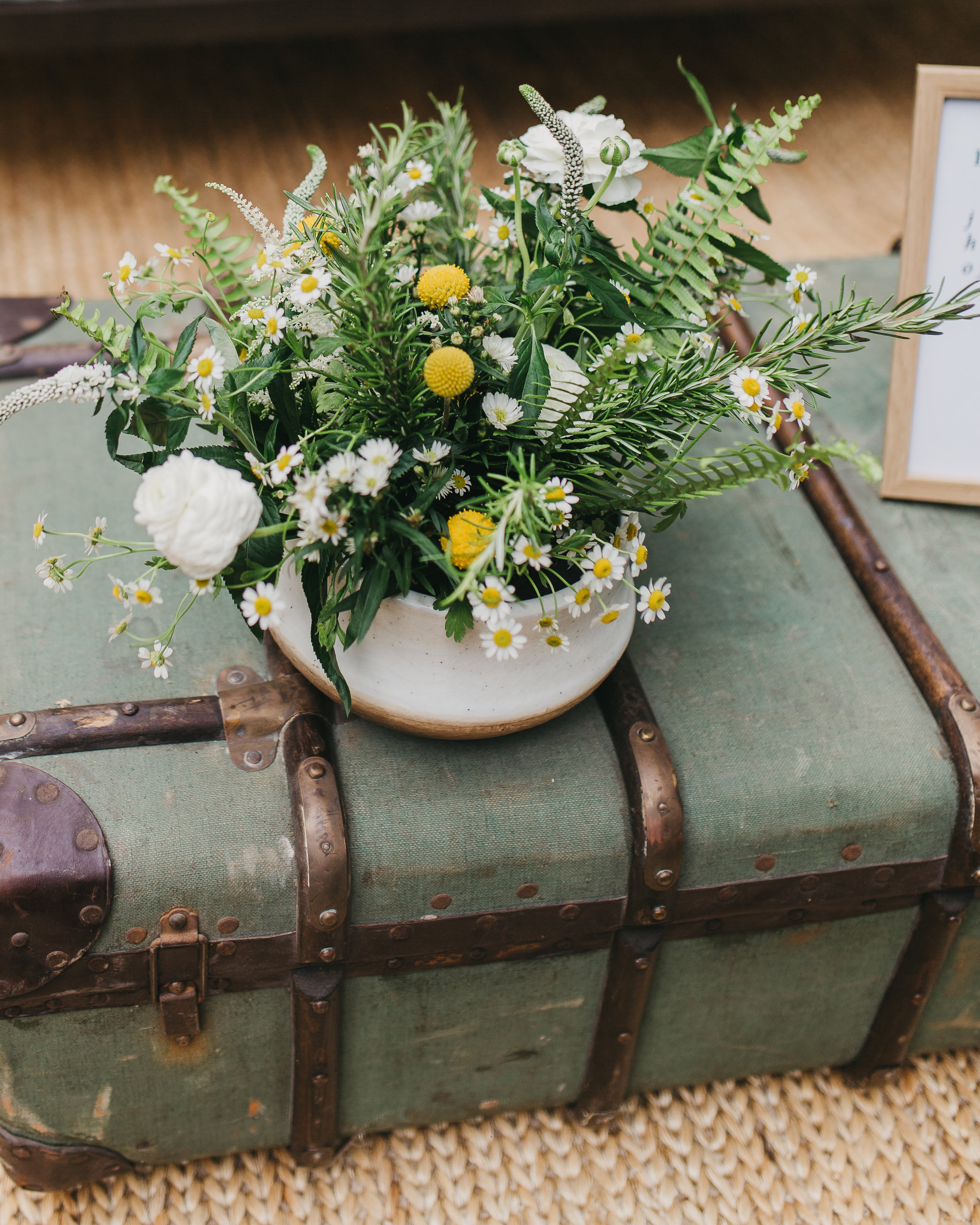 wild greenery arrangement on vintage trunk