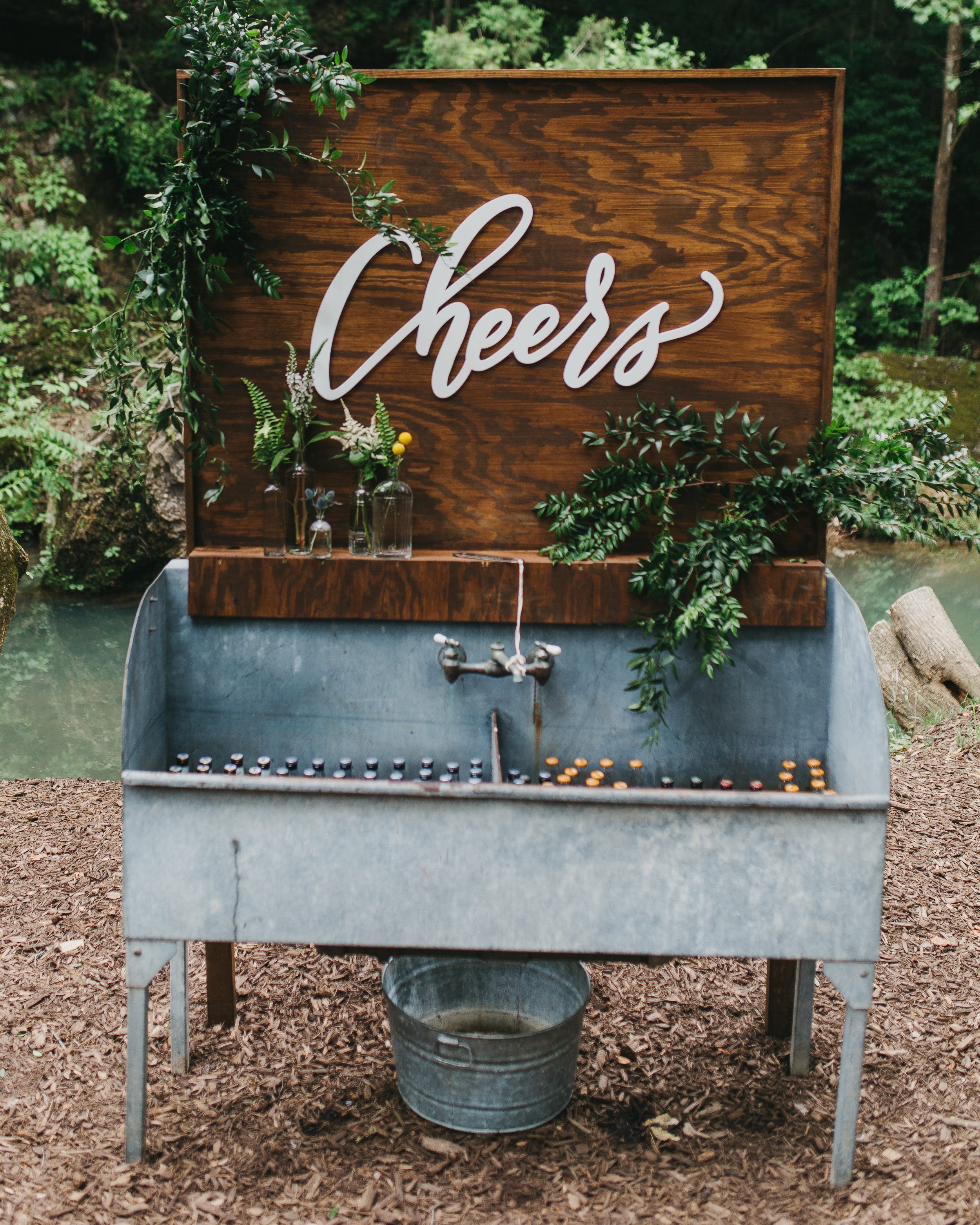beer sink at wedding with cheers sign
