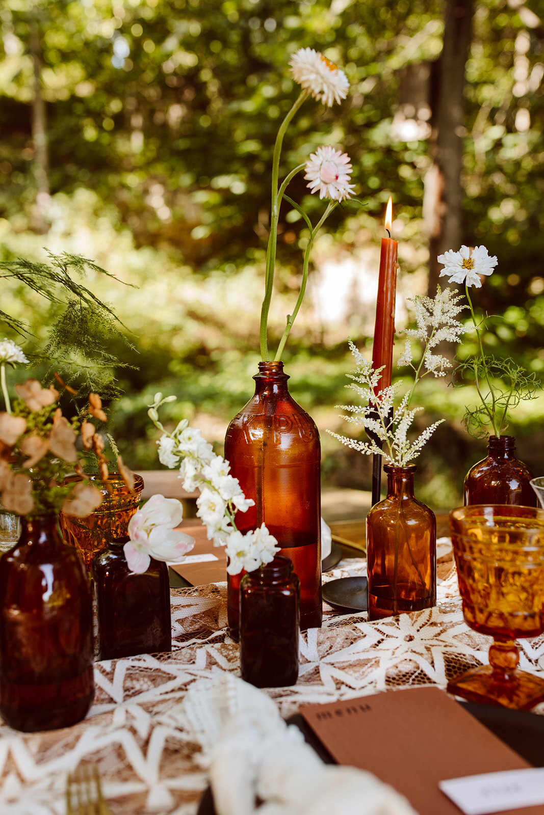 Amber bud vases with starry lace table runner