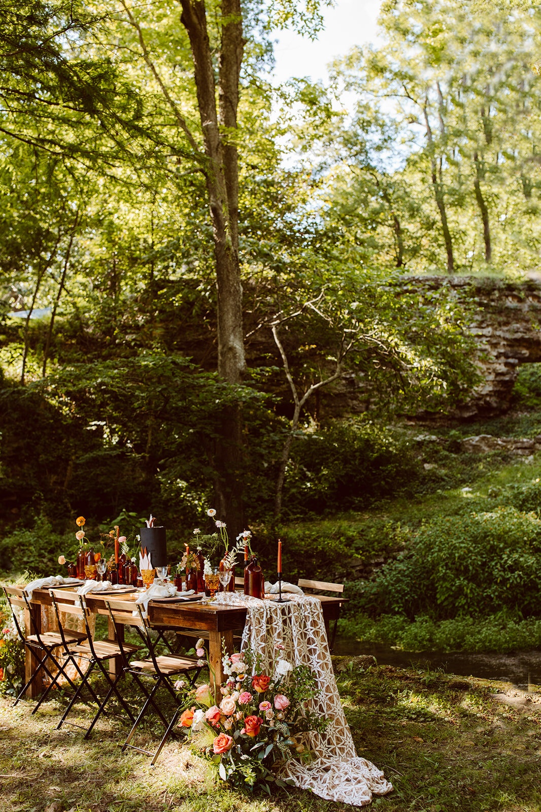 moody and bright wedding tablescape in the woods