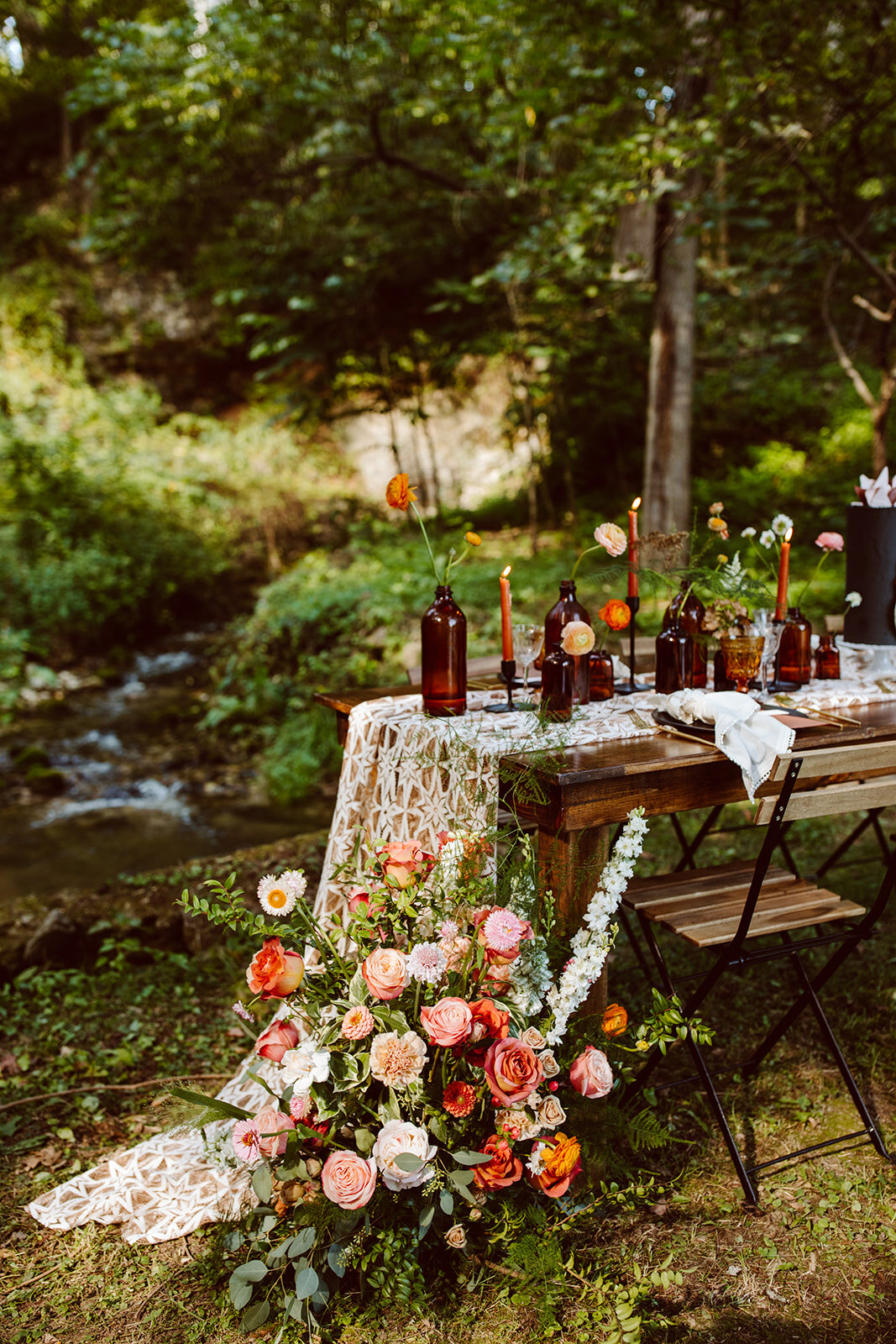 bright floral installation on farmhouse tablescape for wedding
