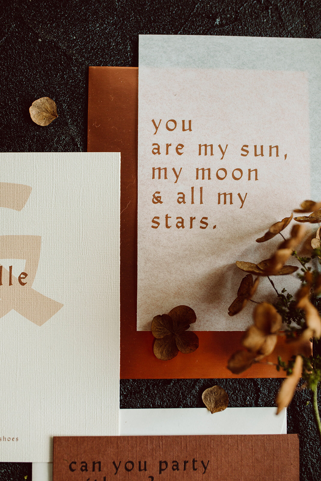 rust and copper invitation suite with dried florals