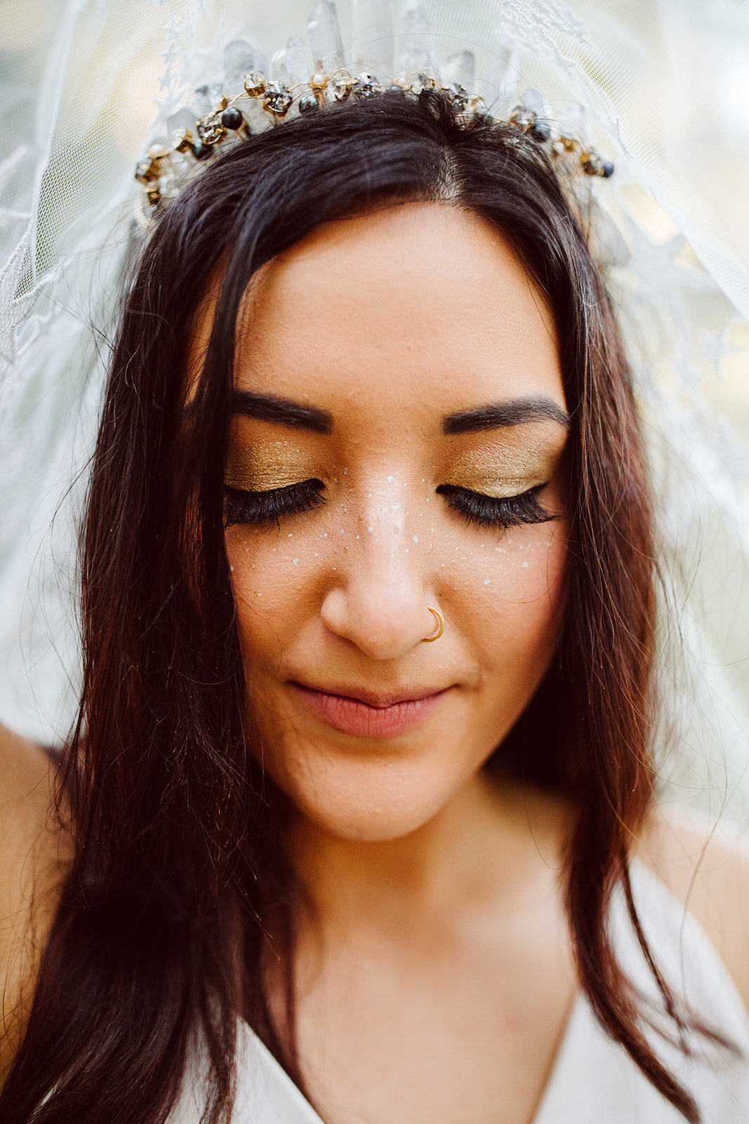 starry gold makeup for wedding with bridal crown