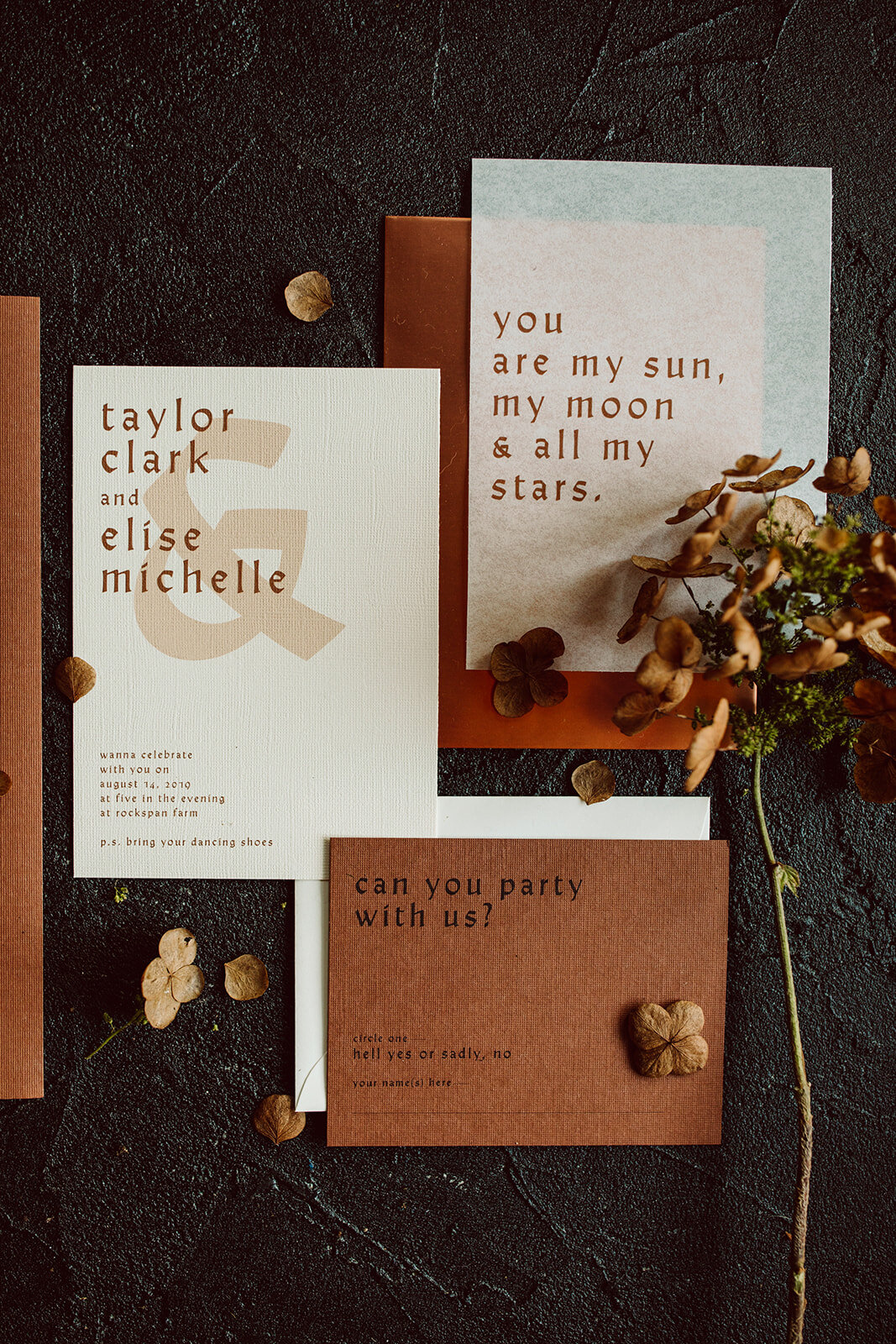 rust and copper wedding invite suite with modern font