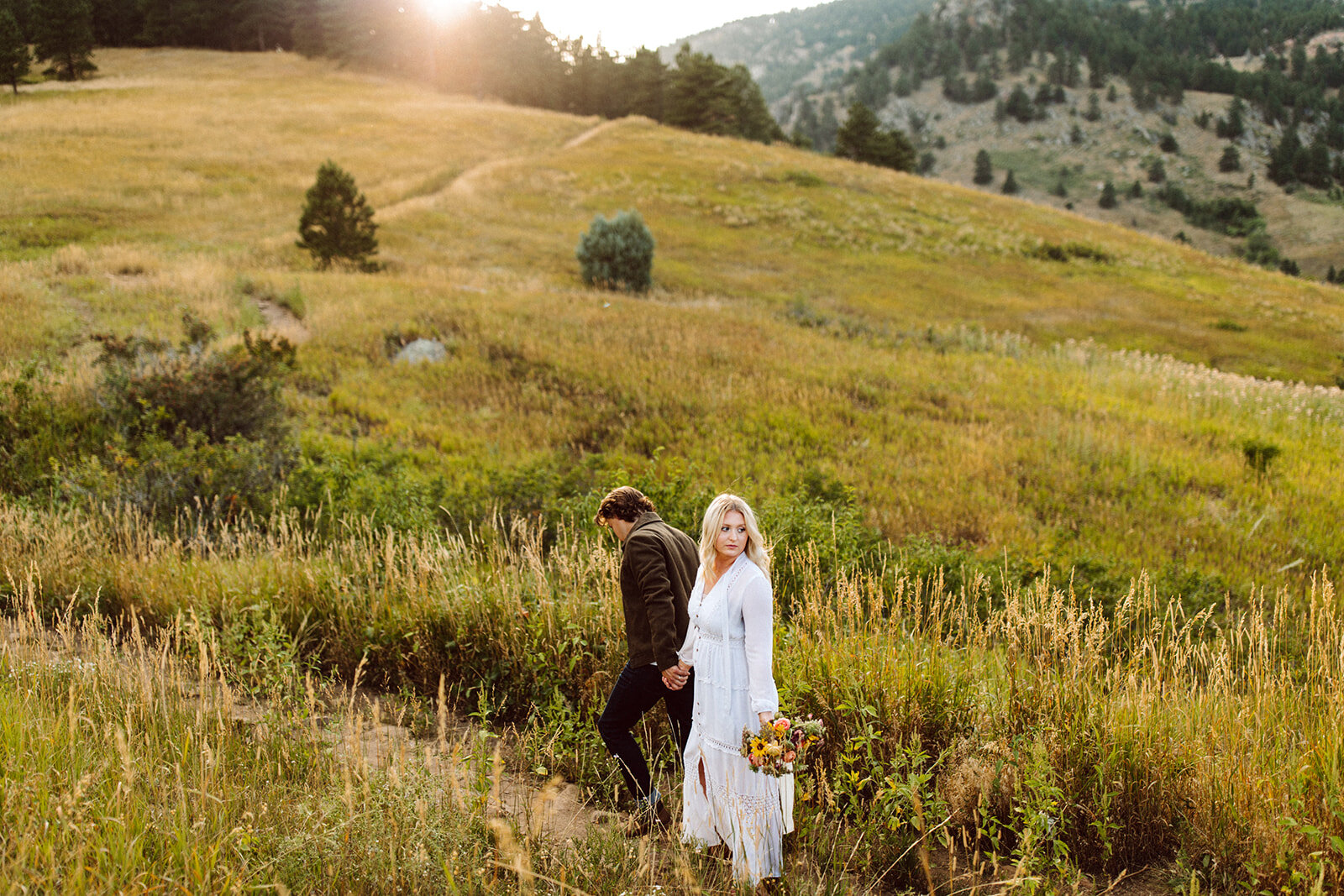 couple elopement with wild boho bouquet in boulder, colorado