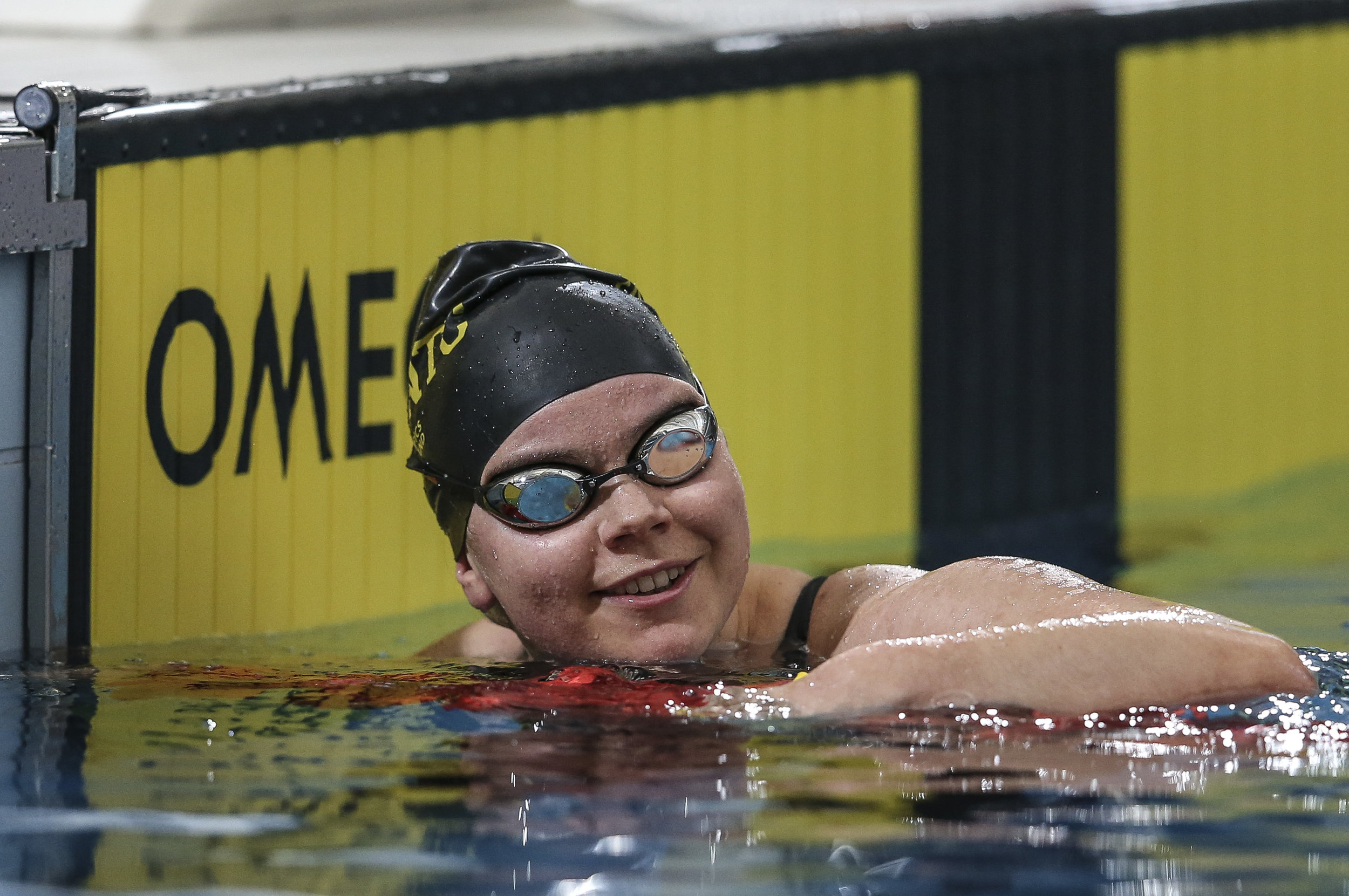 Paralympian Mary Fisher smiling in pool after finishing race