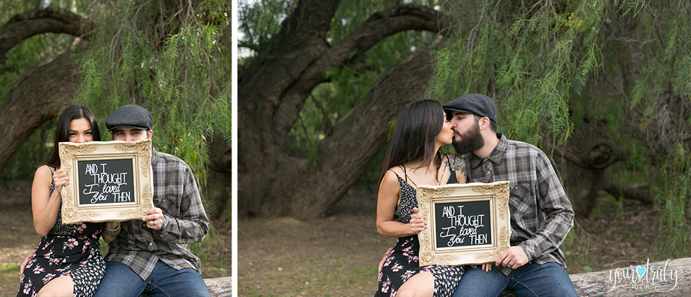 """1-year anniversary photography feature - Couple holding an anniversary sign. """"And I thought I loved you then."""""""