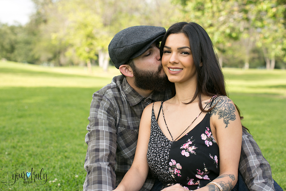 1-year anniversary photography feature - Man kissing woman on the cheek.
