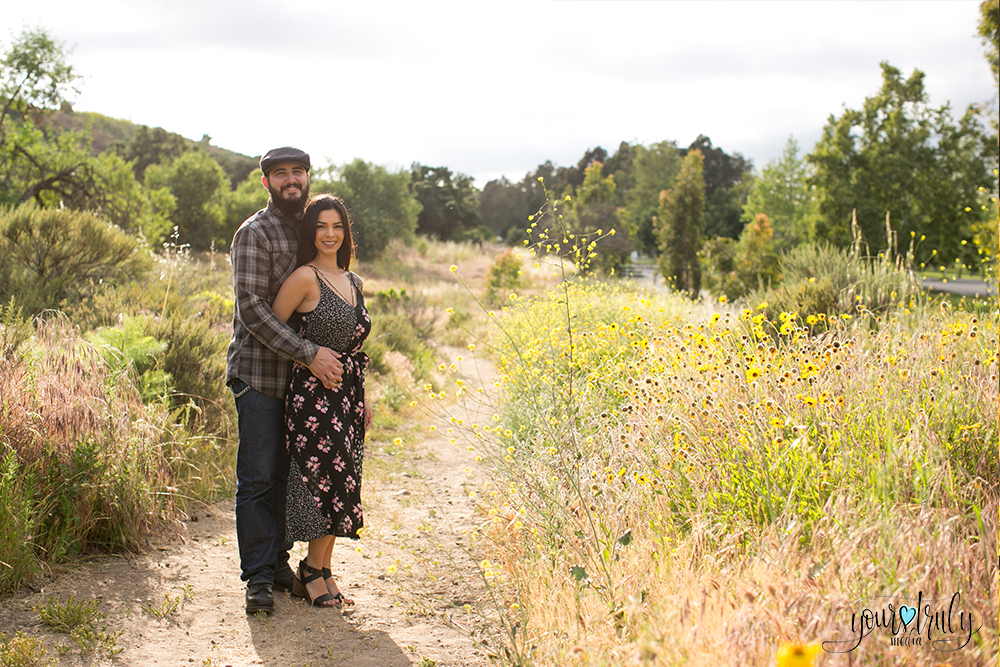 1-year anniversary photography feature - Couple standing in a natural field of color.