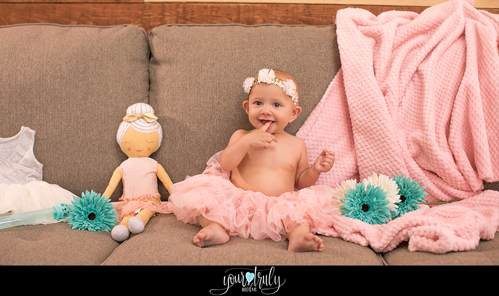 Orange County California Baby Photography Session - Baby girl being photographed while sitting on the couch.