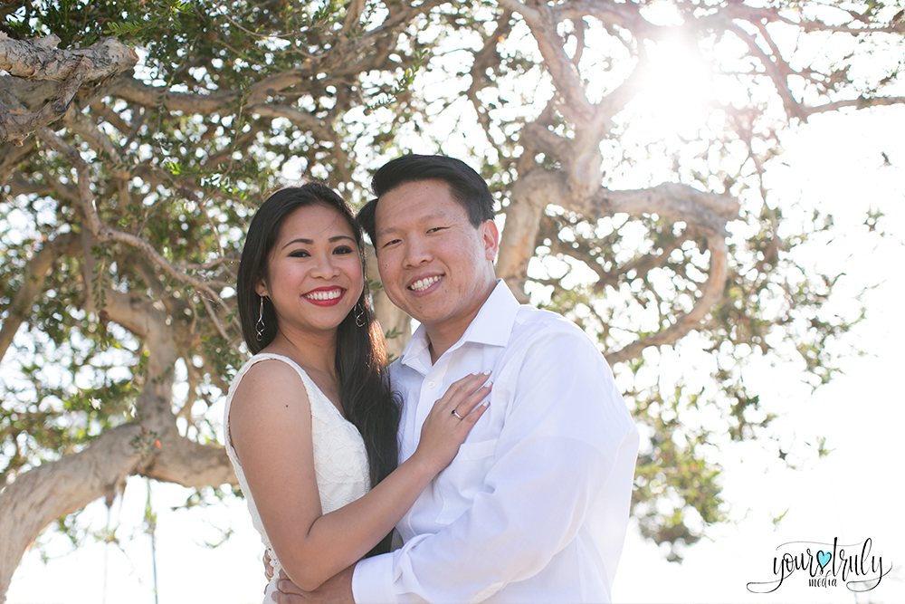 Engagement photography - Laguna Beach, CA - Couple embracing and smiling at the camera.