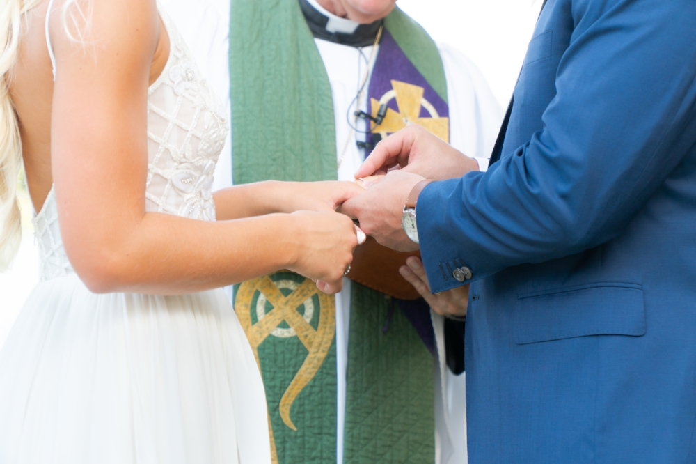 The ring exchange during the wedding ceremony.