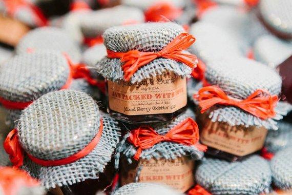 DIY artisan jam with custom labels, and orange ribbons.   Photo credit: Etsy SouthernJamsandJelly