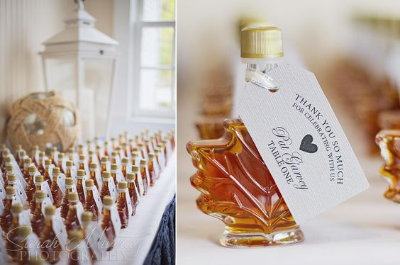 A maple syrup wedding favor in the shape of a maple leaf with a wedding thank you card attached.   Photo credit: Sarah Murray Photography