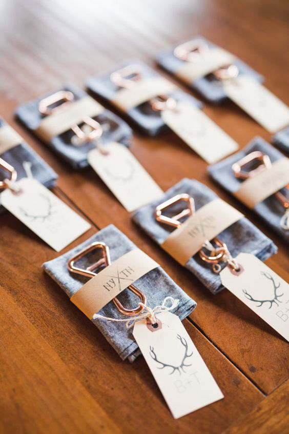 Personalized champagne colored bottle openers packaged with handkerchiefs and small tags.   Photo credit: Ashley Caroline Photography