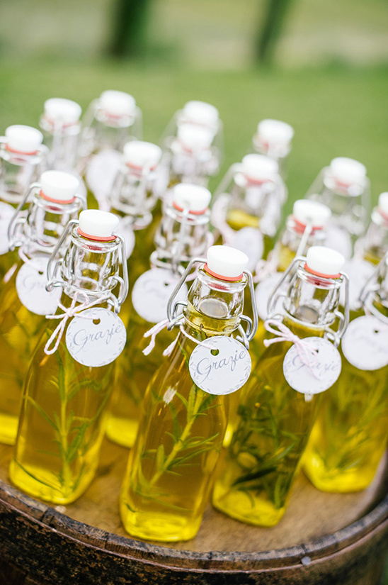 Bottles of olive oil packaged in DIY bottles with tags attached with twine.   Photo Credit: Die Hochzeitsfotografen