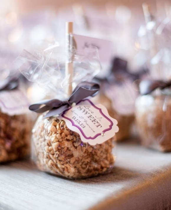 Individually wrapped caramel apples with grey ribbons and custom labels.   Photo Credit: Maya Myers Photography