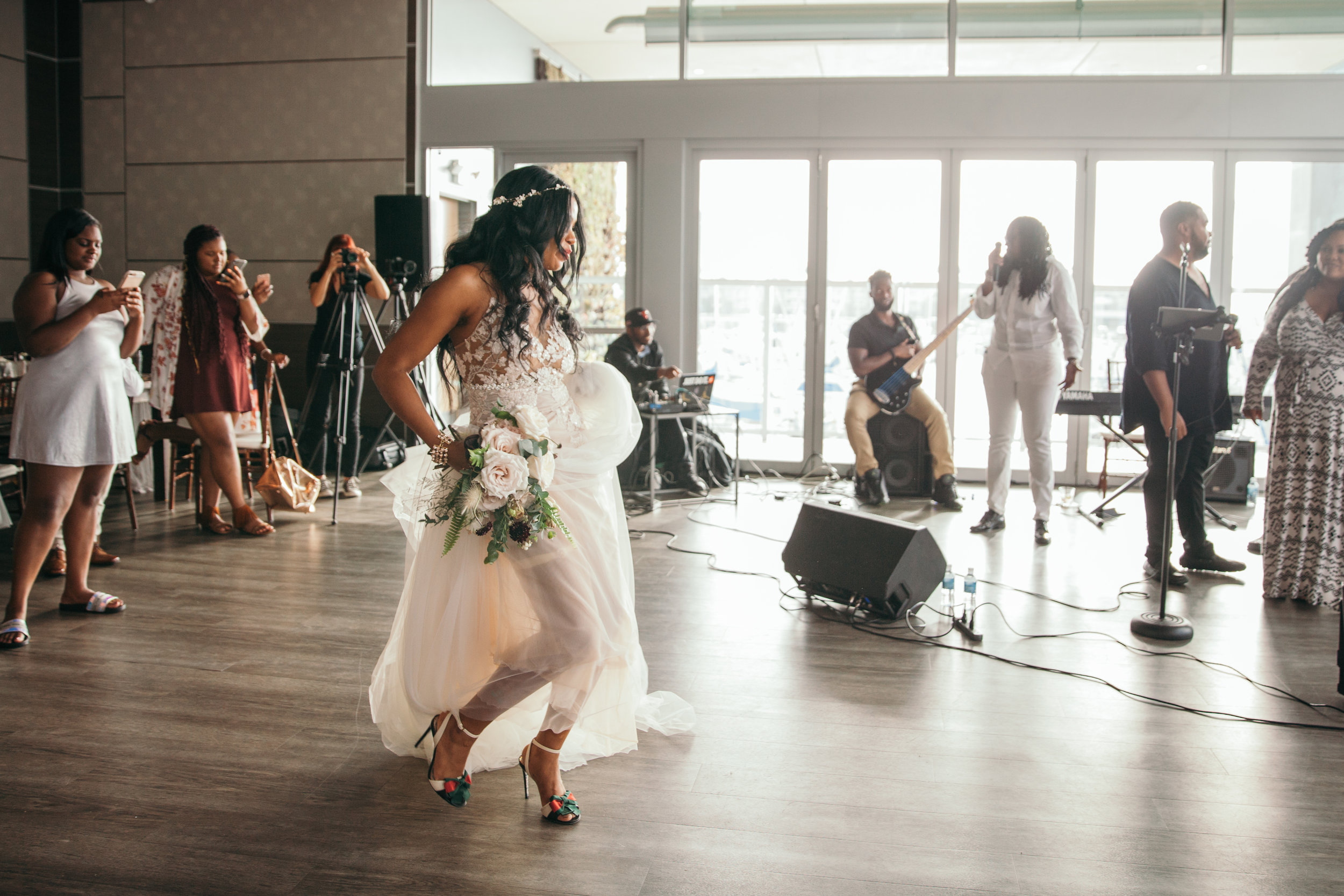 Bride dancing to her wedding band.