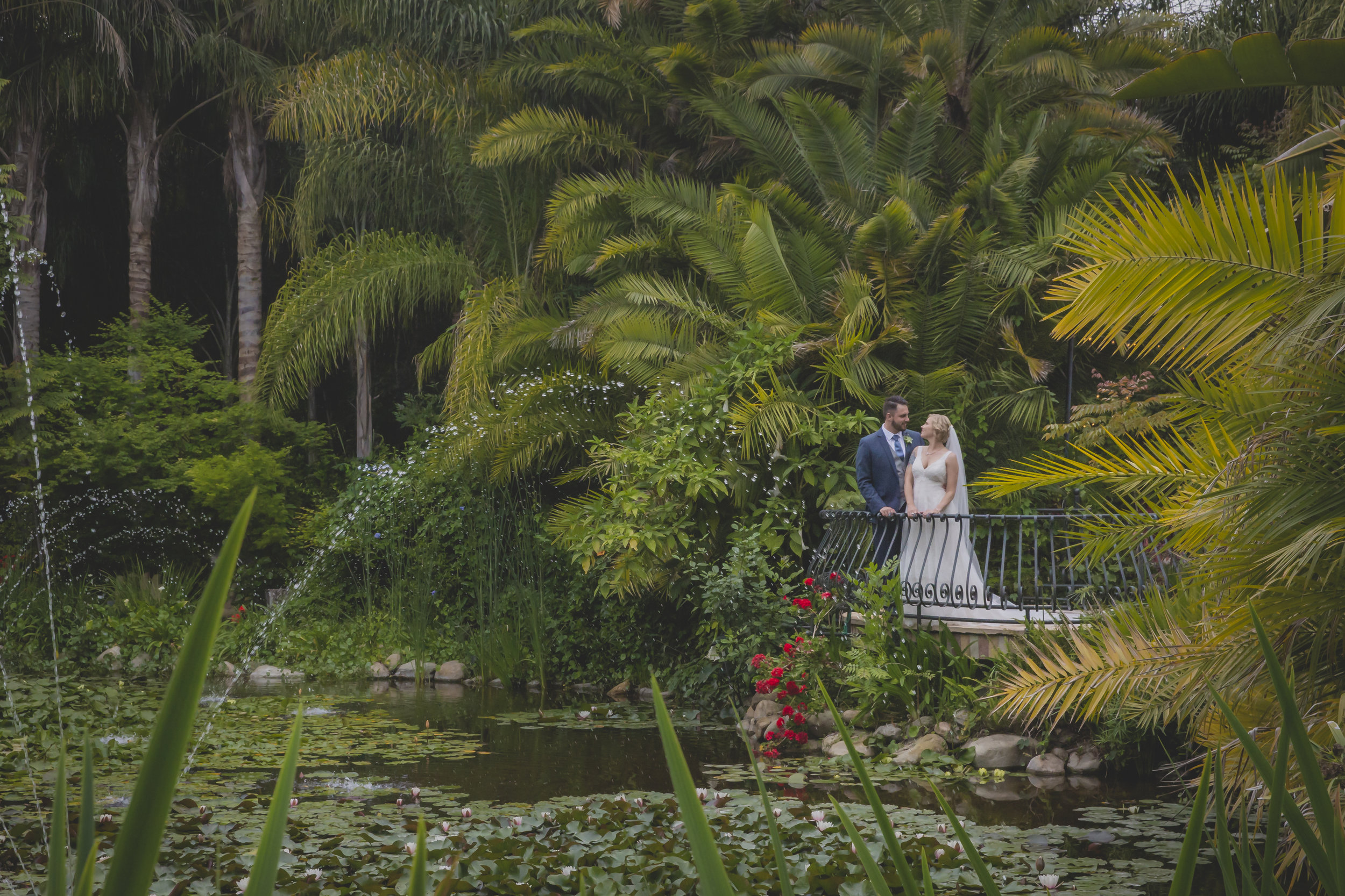 Wedding photography - Edens Gardens, Moorpark California Wedding Venue - Bride and groom facing each other overlooking a pond