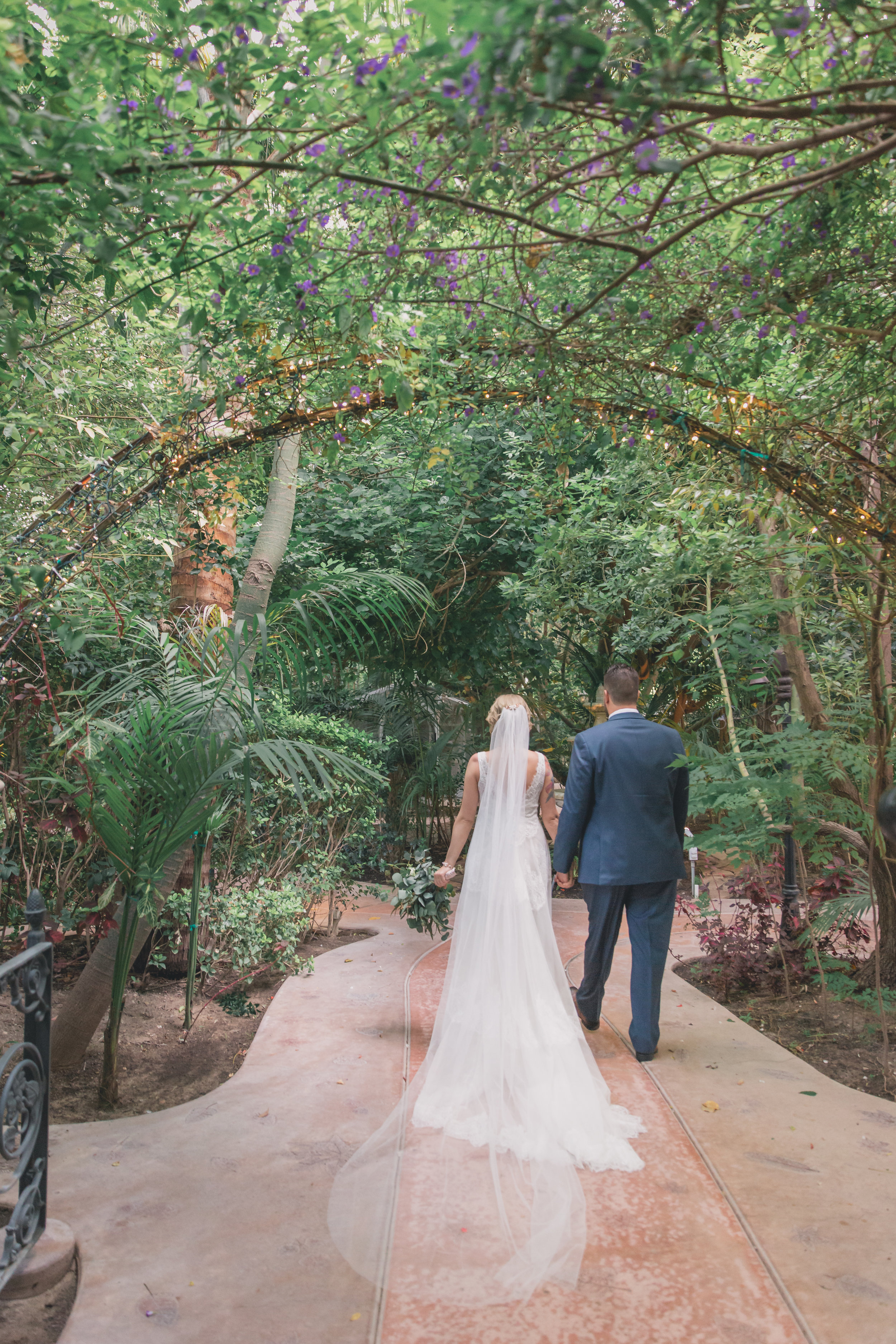 Wedding Photography - Edens Gardens, Moorpark California Wedding Venue - Bride and groom walking hand in hand through the gardens