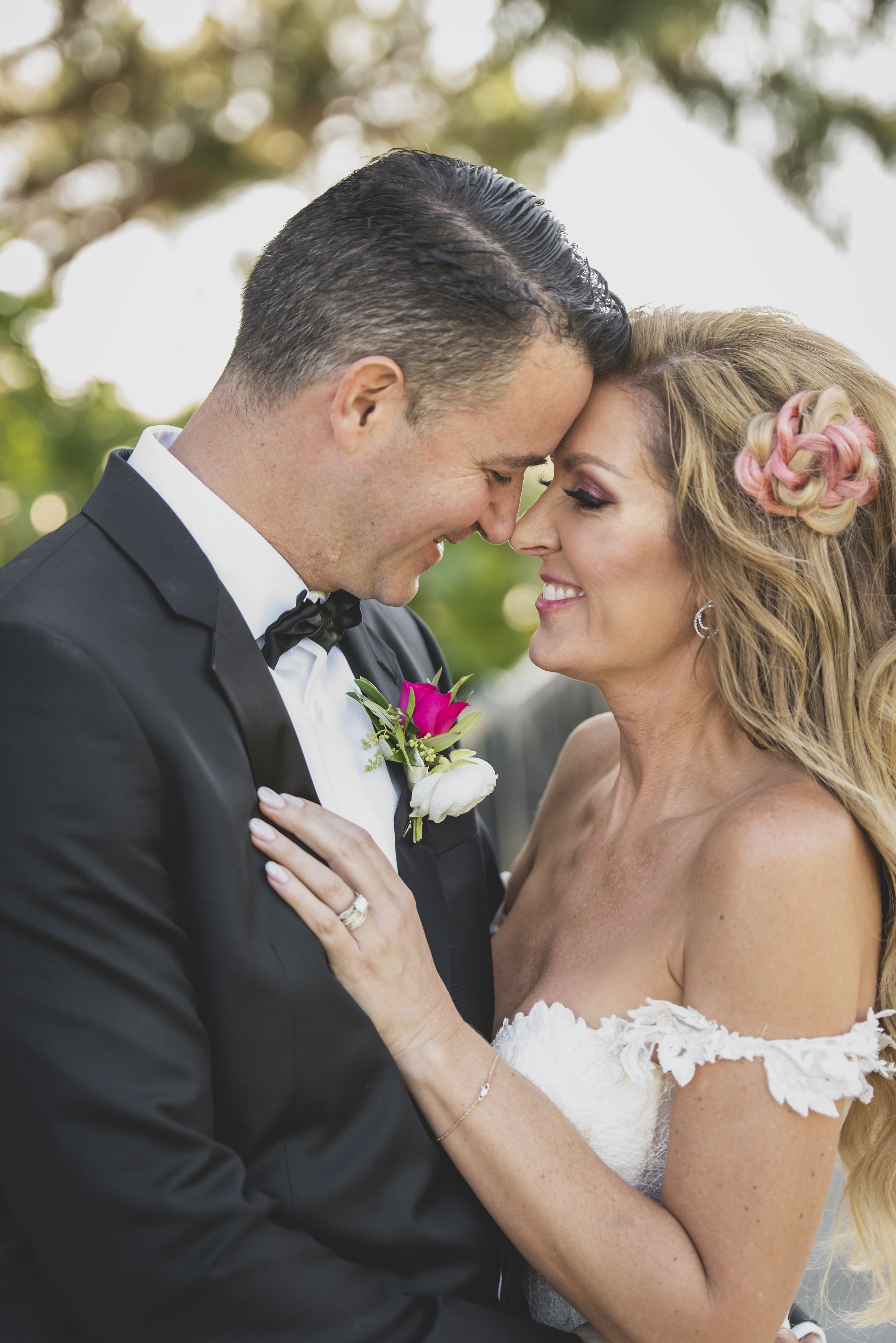 Wedding Photography Packages - Heritage Park, Dana Point, CA - Bride and groom touching foreheads with smiles on their faces.