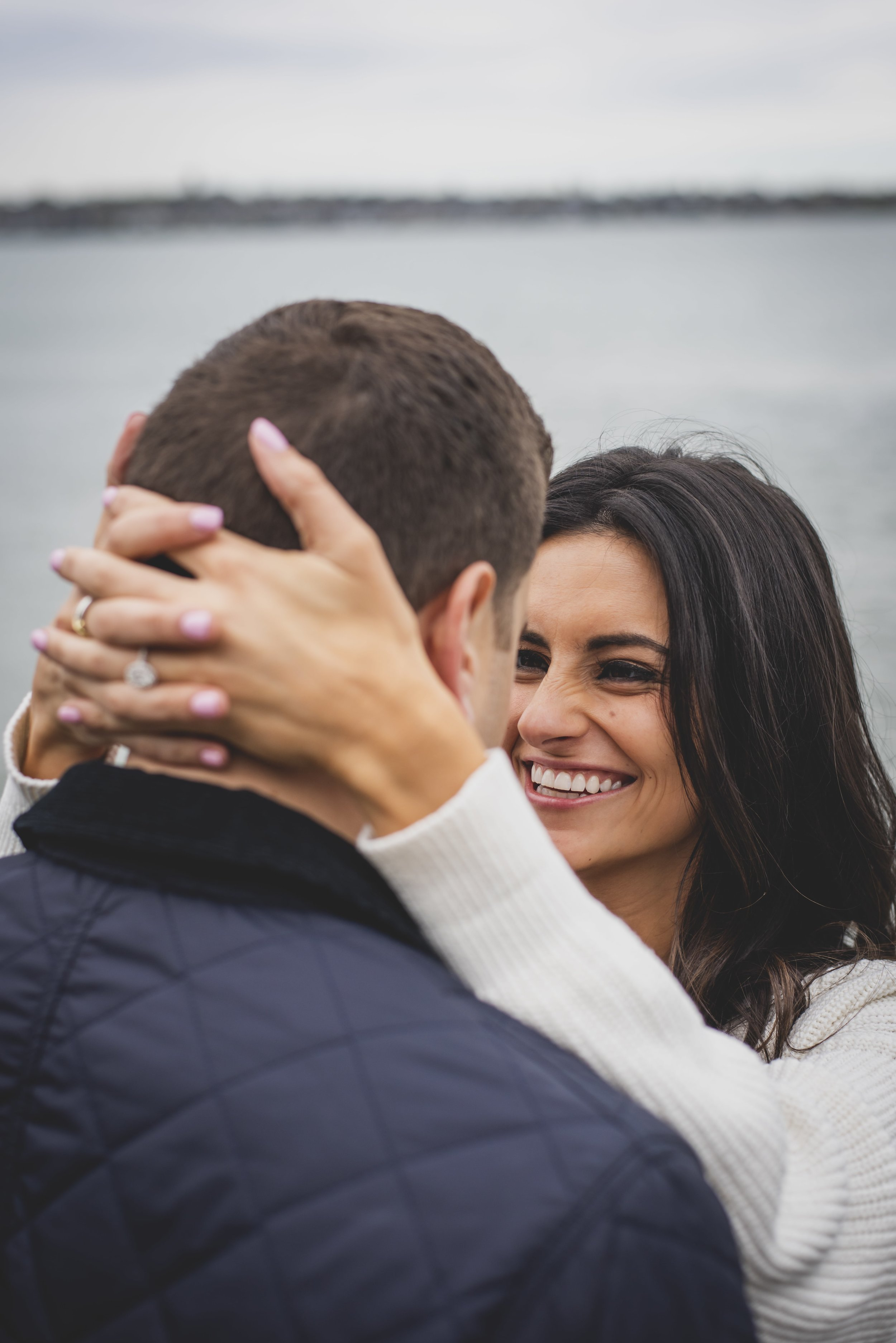 Engagement Photography Services - Castle Hill Lighthouse, Newport, RI - Couple staring into each others eyes and laughing joyously.