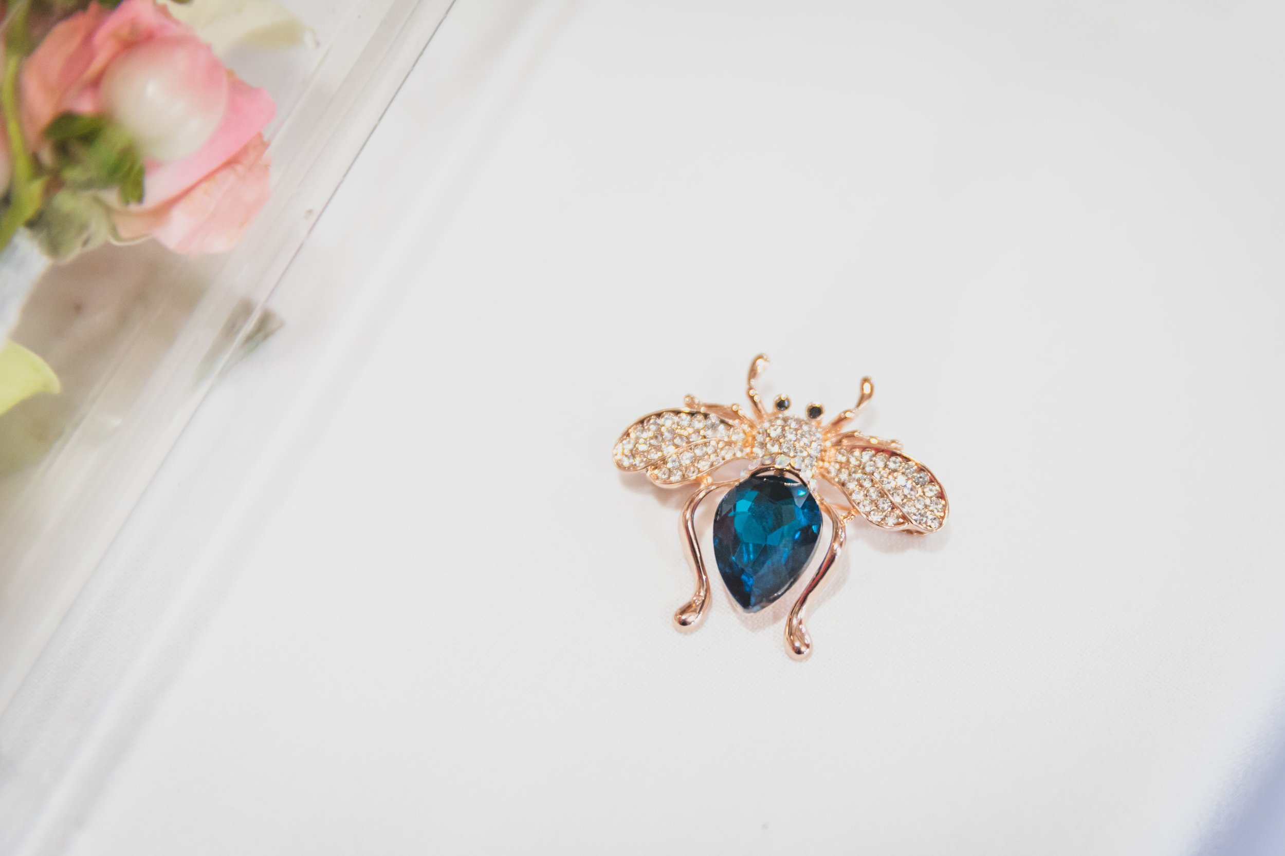 Wedding Photography - Something Old, Something New, Something Borrowed, Something Blue - Blue Sapphire set in an ornamental brooch
