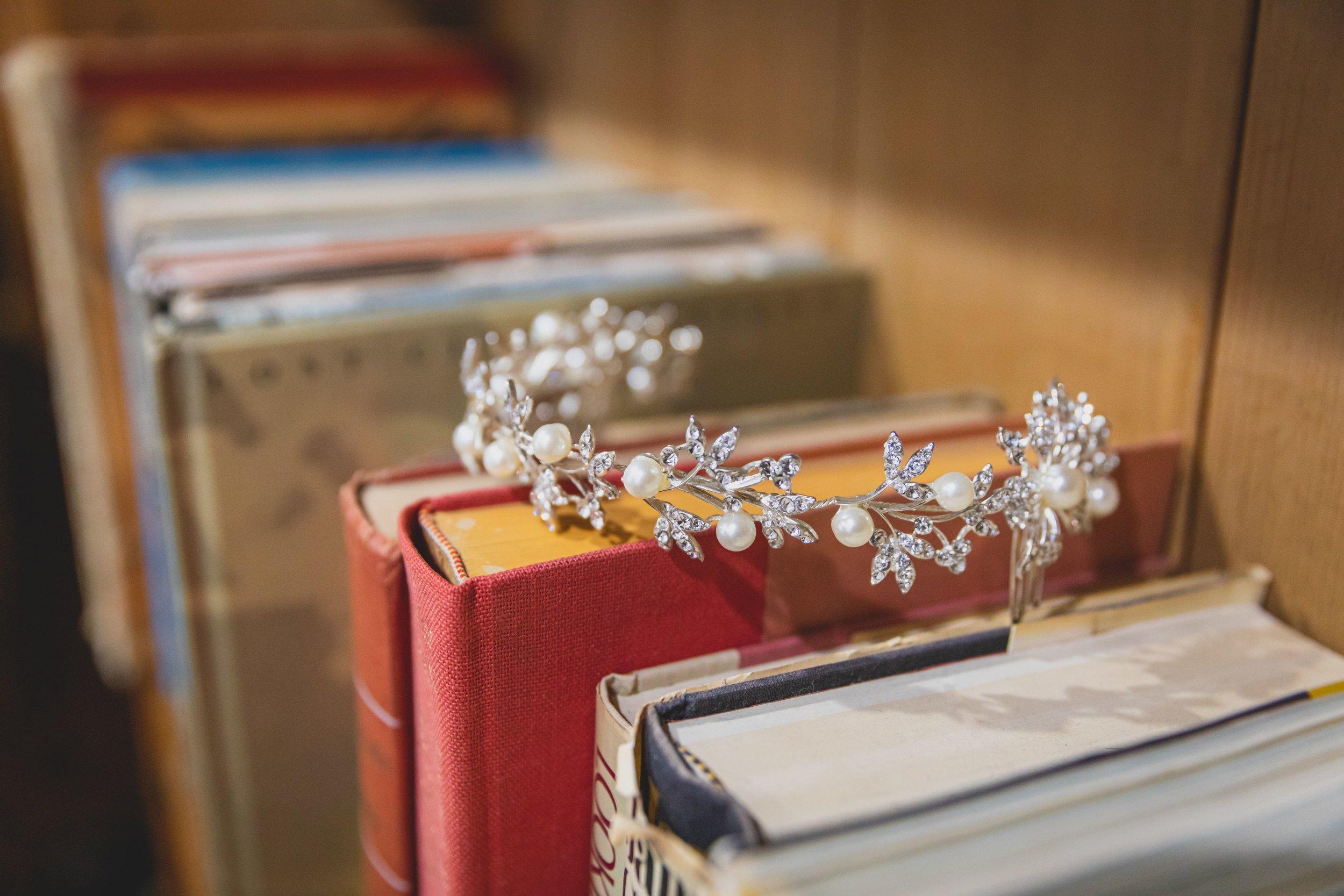 Wedding Photography - Something Old, Something New, Something Borrowed, Something Blue - Wedding tiara photographed on a bookshelf