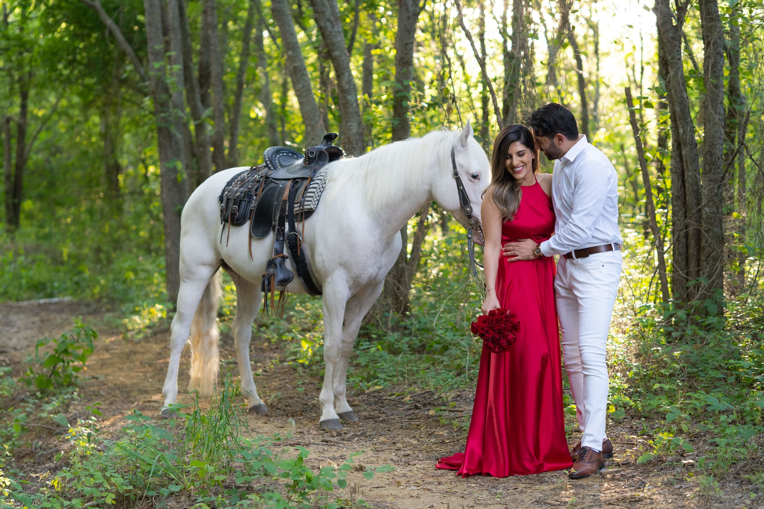 Engagement Photography Services Lucas, TX - Newly engaged couple going horseback riding through the woods.