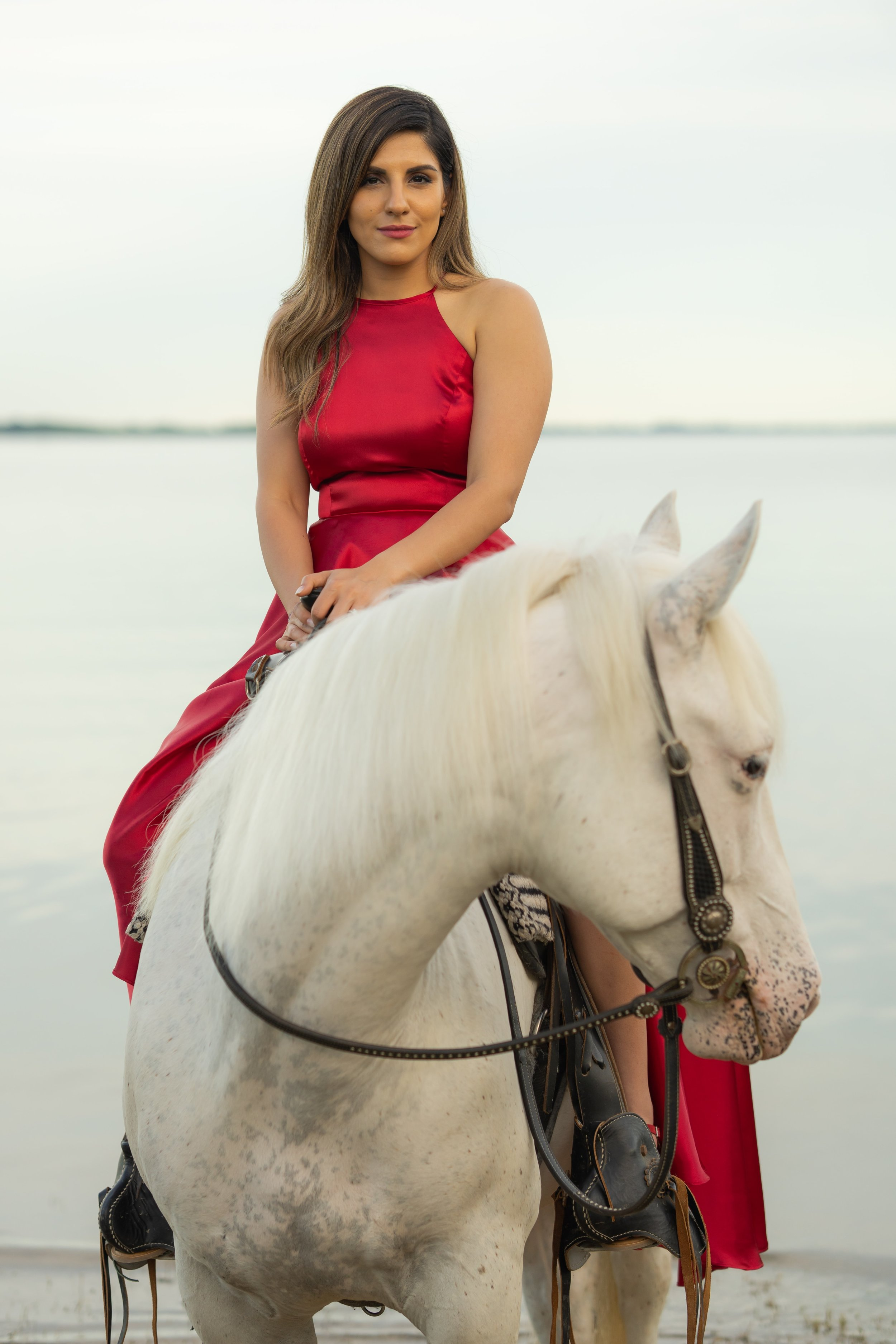 Engagement Photography Services Lucas, TX - Woman in red dress sitting upon a white horse.