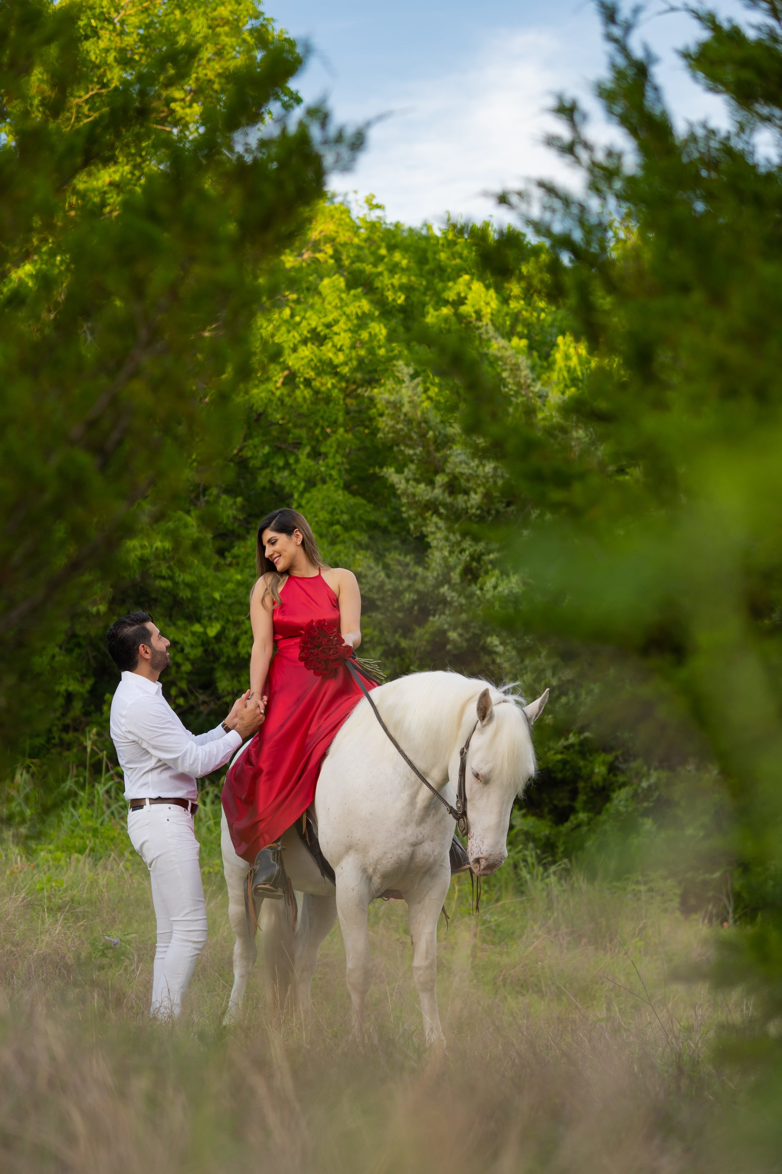 Engagement Photography Services Lucas, TX - Engaged couple holding hands while horse back riding.