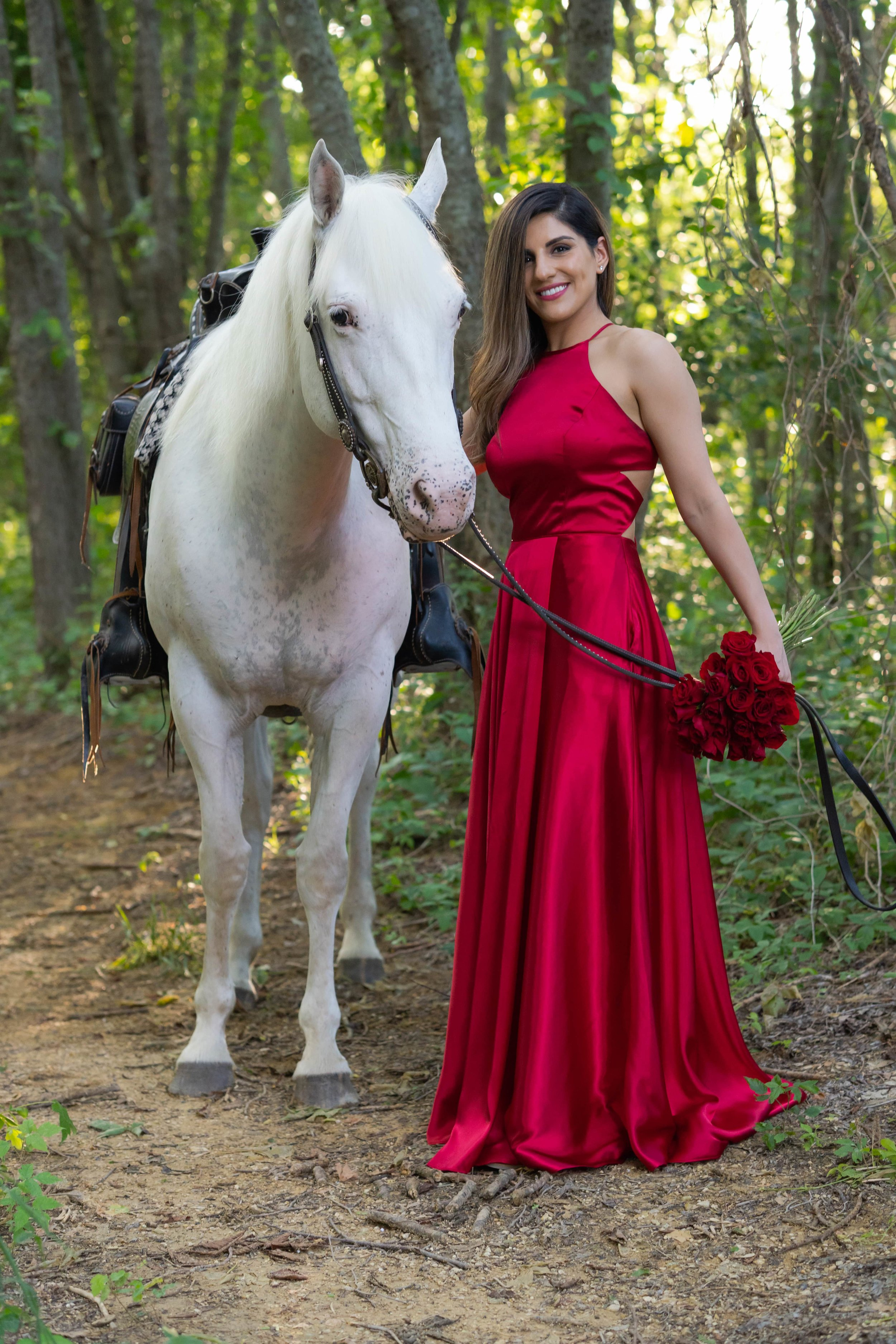 Engagement Photography Services Lucas, TX - Woman in red dress holding the reins of a white horse.