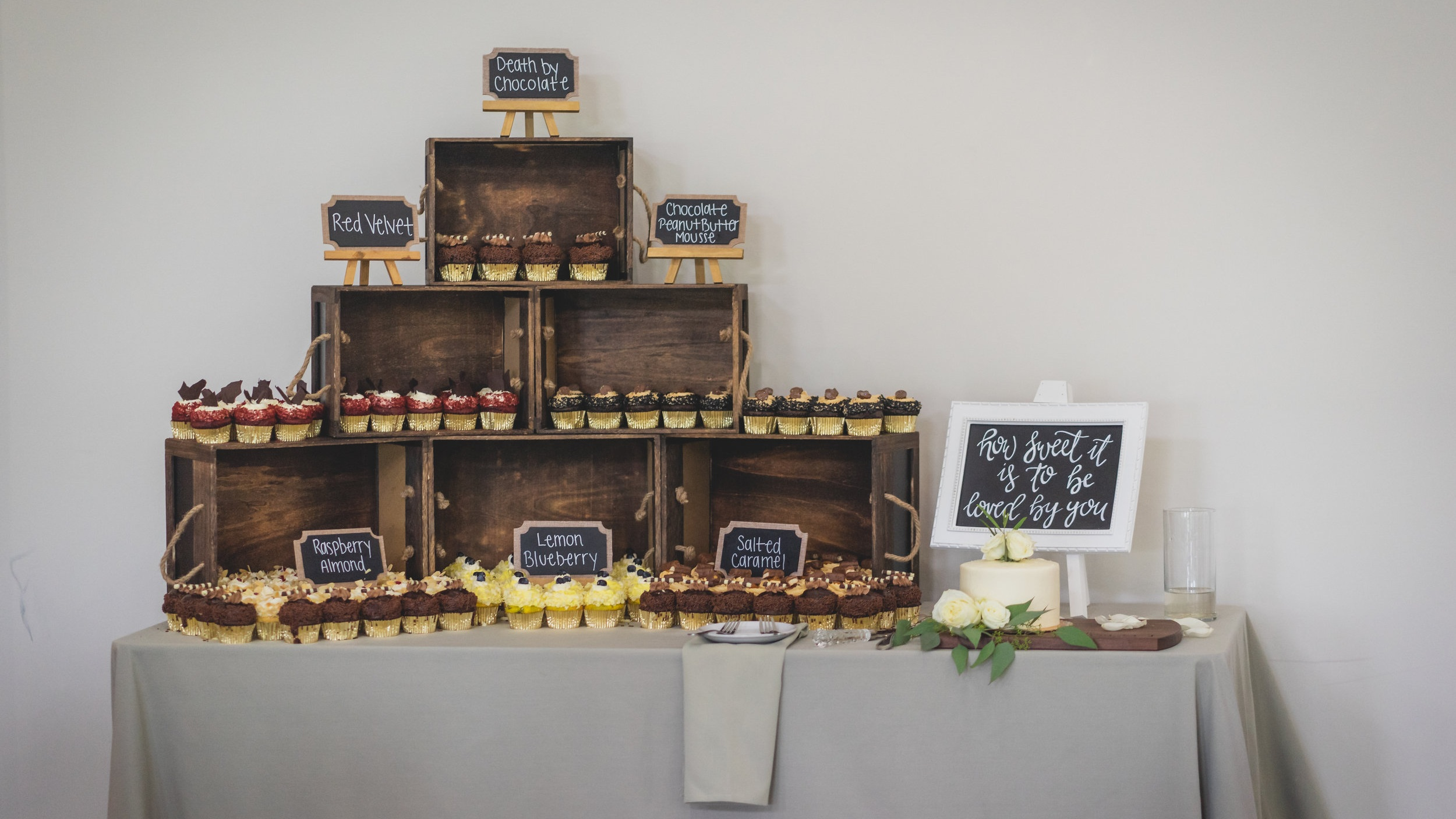 Rustic themed wedding - DIY dessert table featuring hand-crafted wooden signs.