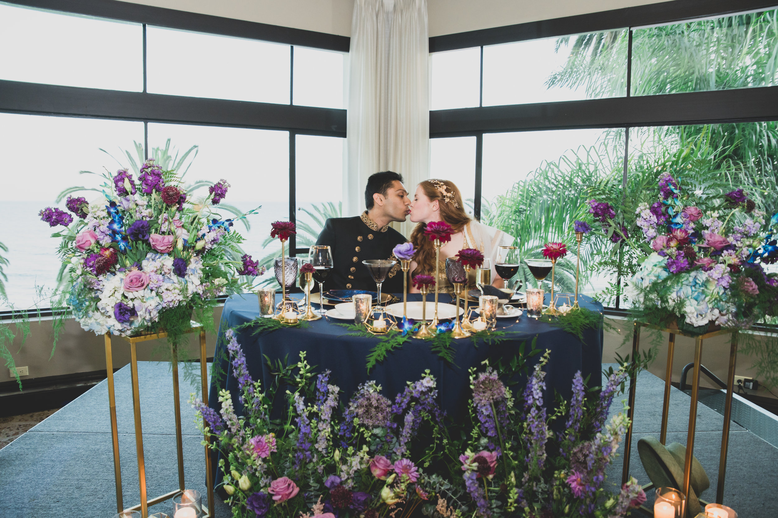 Modern Wedding Theme - Bride and at head table featuring flowers with vibrant colors and geometric shapes.
