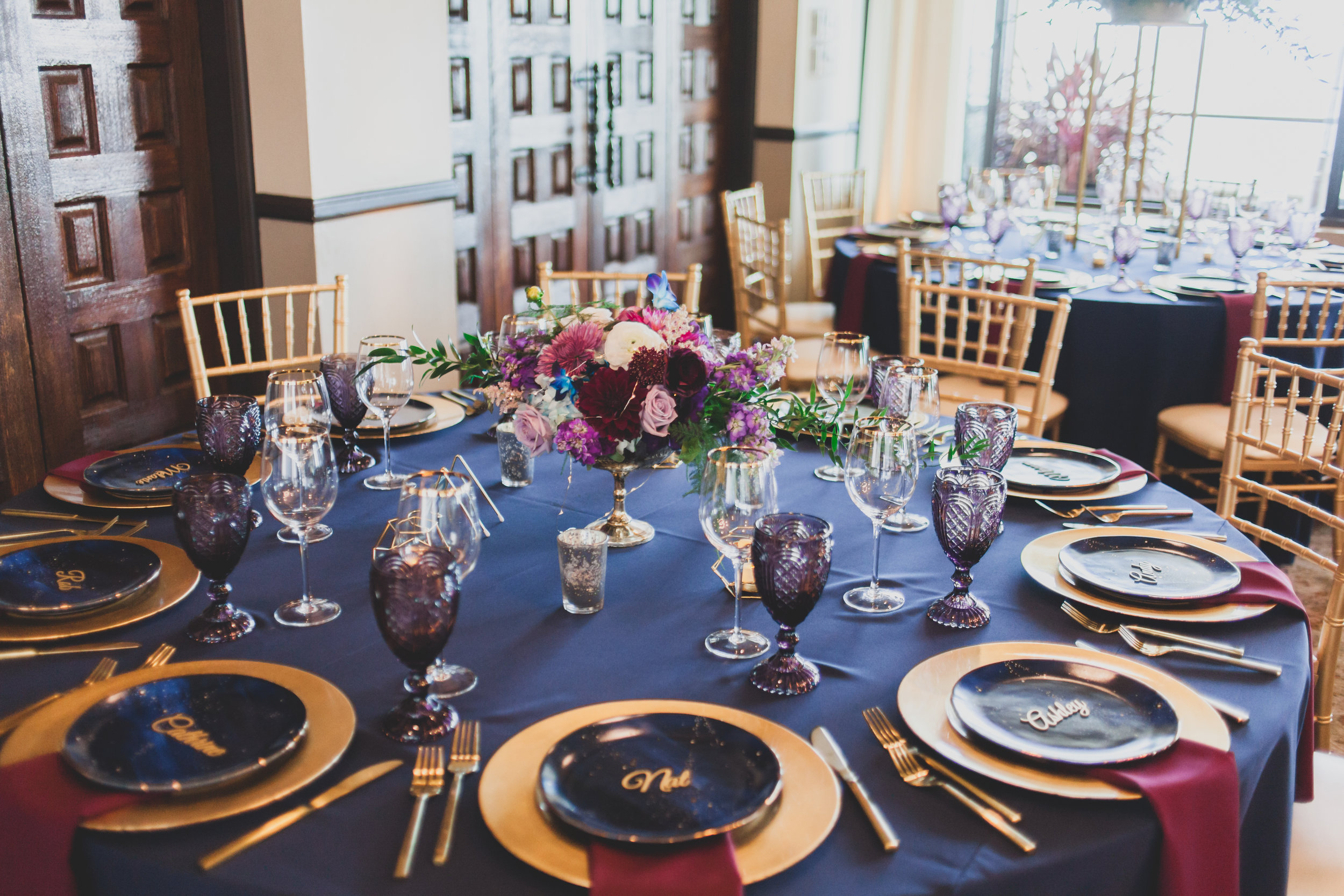 Modern Wedding Theme - Guest tables featuring a mixture of materials and deep earth tones.