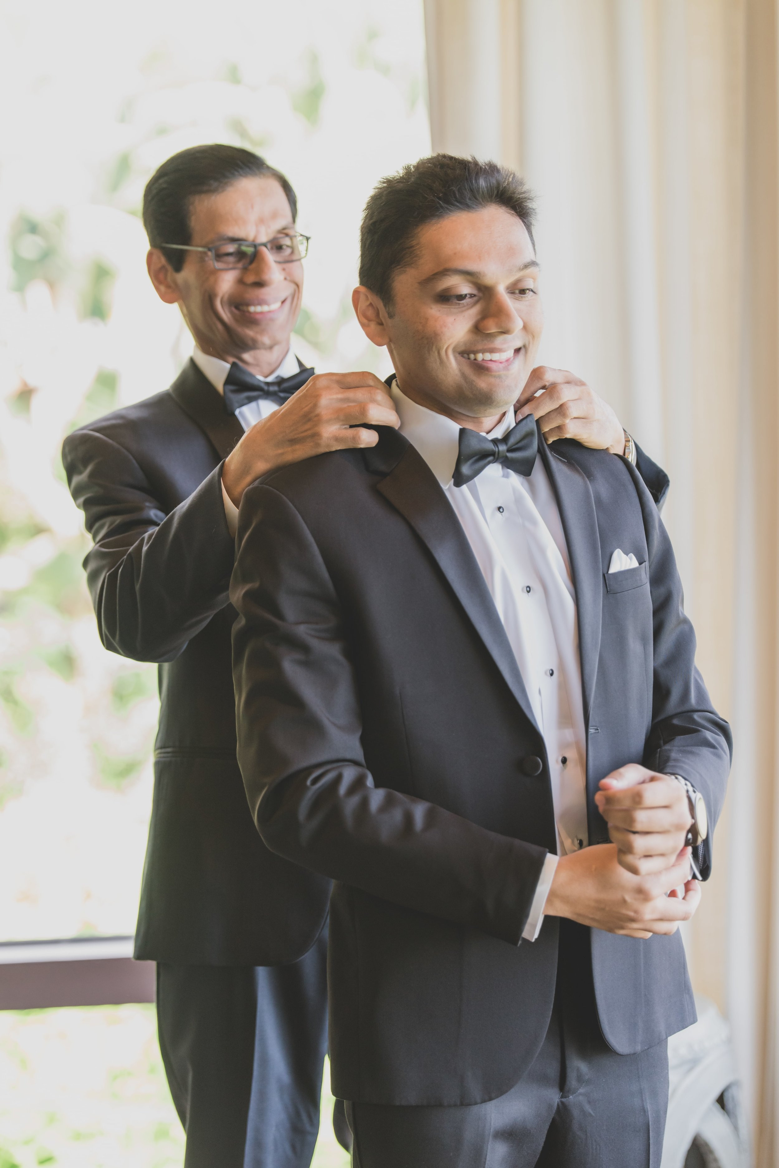 Wedding Photography - Pacific Palisades, CA - Bel Air Bay Club - The grooms father straightening the grooms collar as he gets ready.