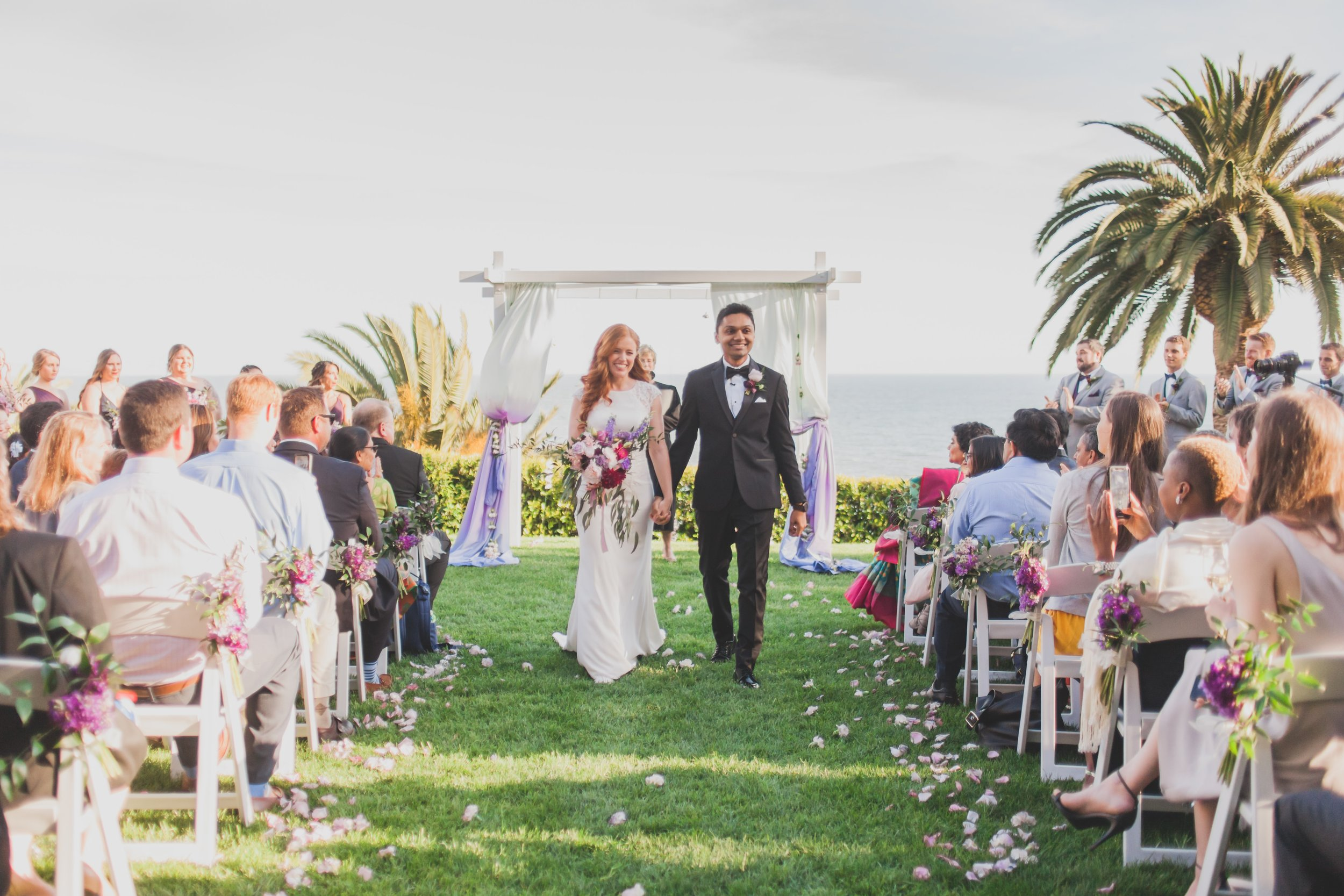 Wedding Photography - Pacific Palisades, CA - Bel Air Bay Club - The bride and groom making their exit down the aisle after their ceremony.