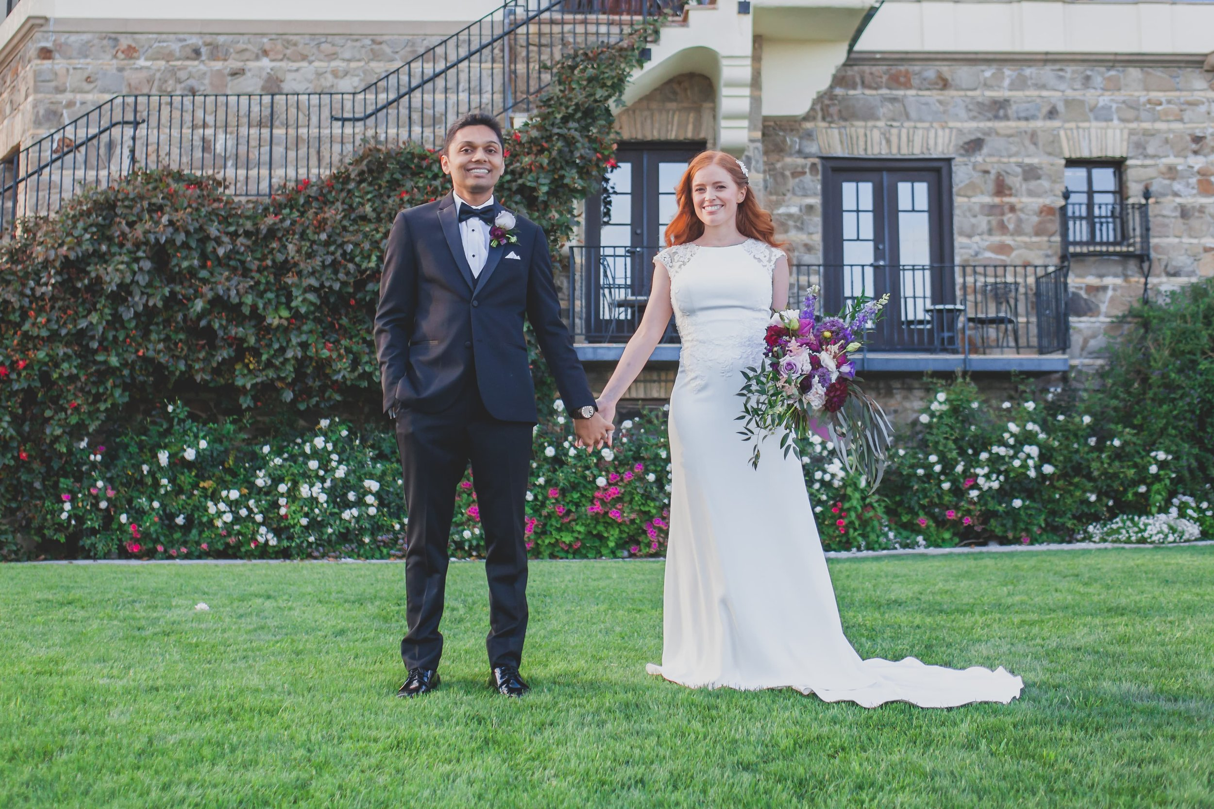Wedding Photography - Pacific Palisades, CA - Bel Air Bay Club - Bride and groom holding hands in front of their wedding venue.