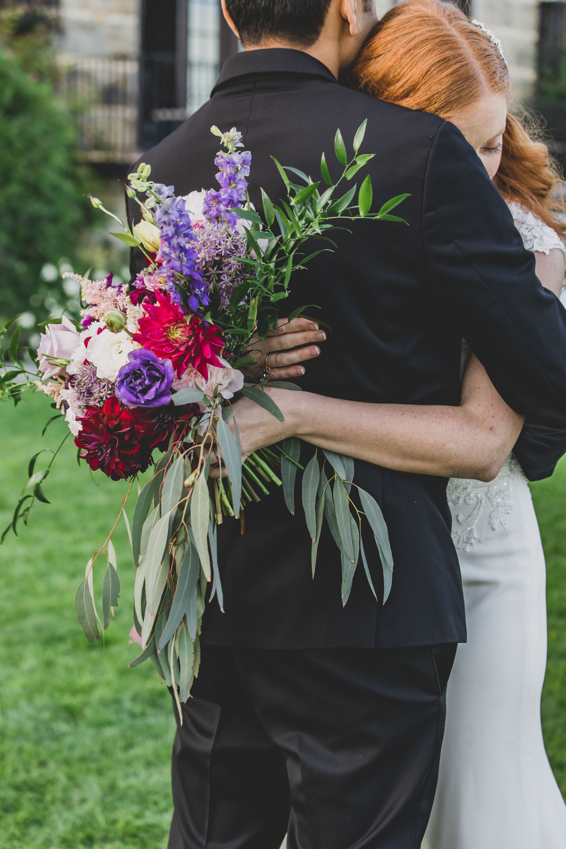 Wedding Photography - Pacific Palisades, CA - Bel Air Bay Club - The groom hugging his bride after their first look.
