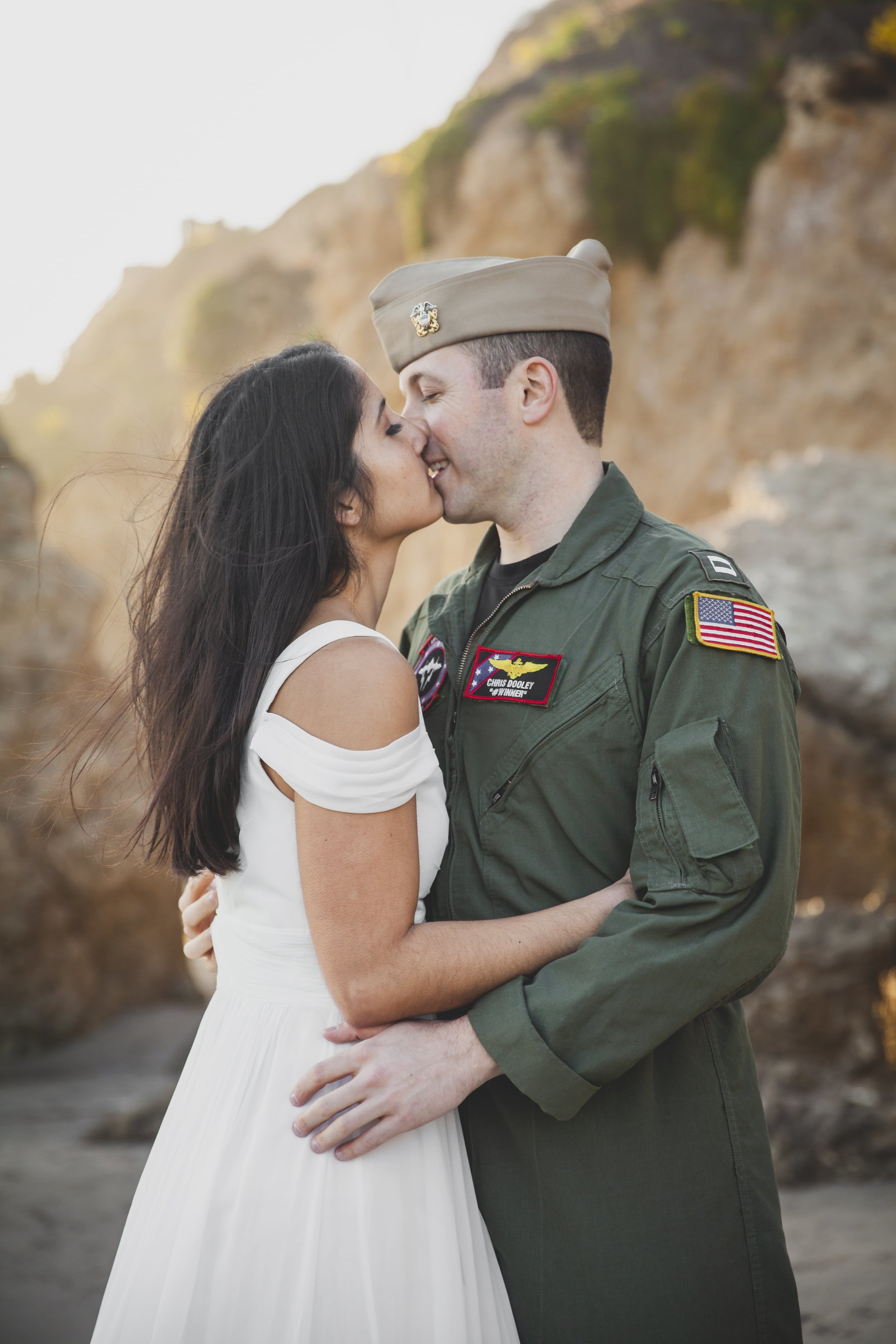 California Engagement Photography - Man in green military uniform kissing his soon to be bride.