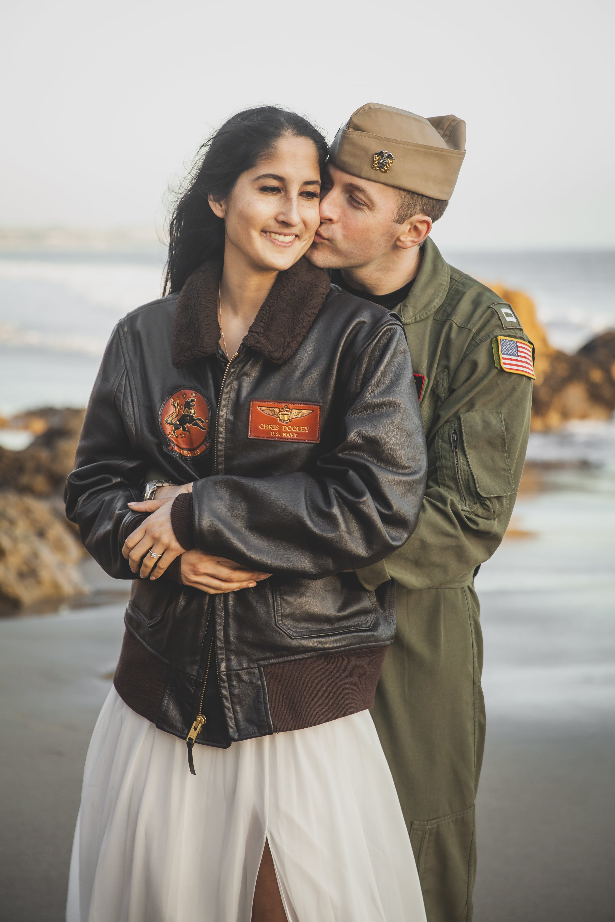 California Engagement Photography - US Navy Man with his arms wrapped around his fiance, while she wears his naval jacket.
