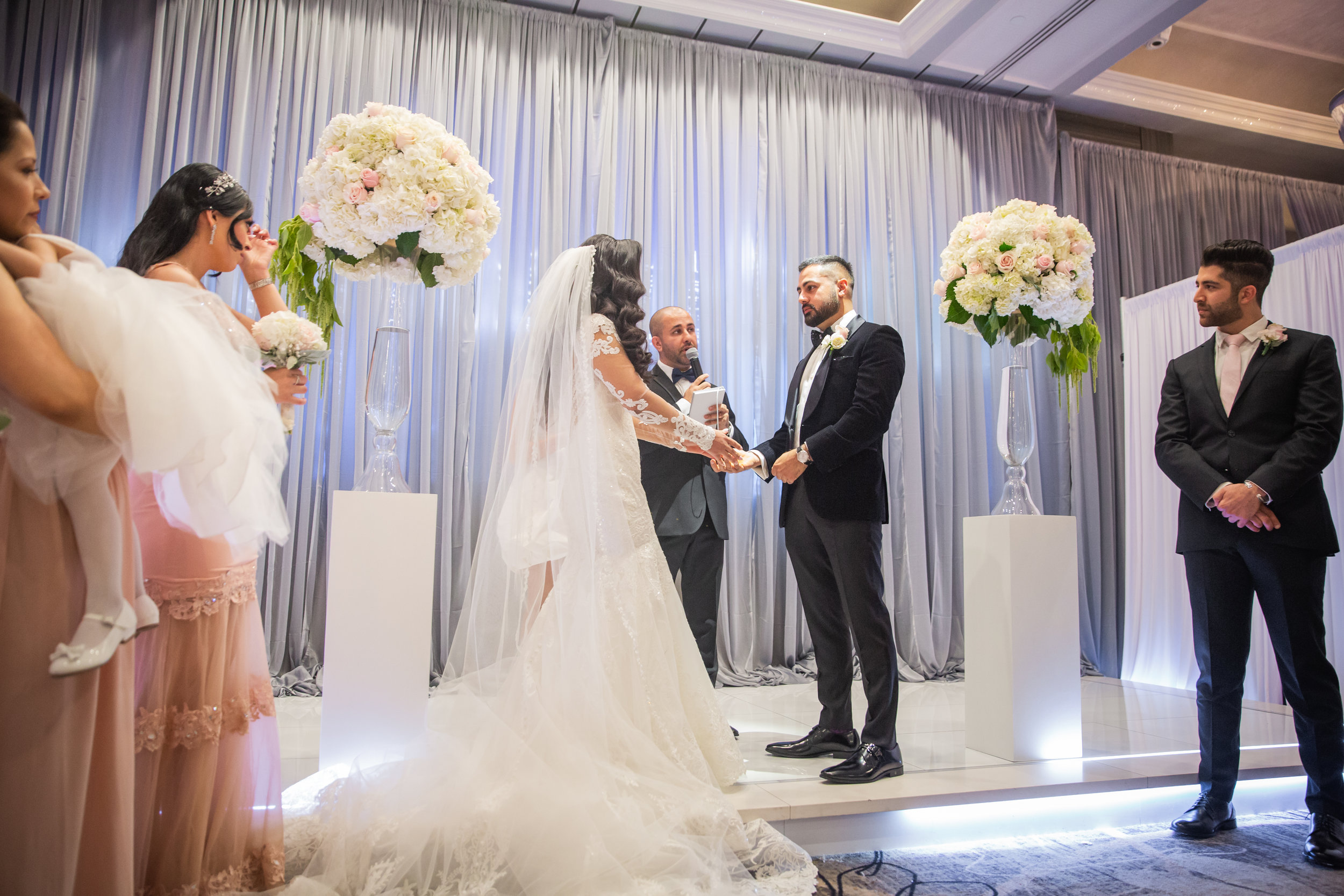 Romantic Wedding Theme Feature - Glendale, CA - Legacy Ballroom - The bride and groom exchanging vows during their wedding ceremony.