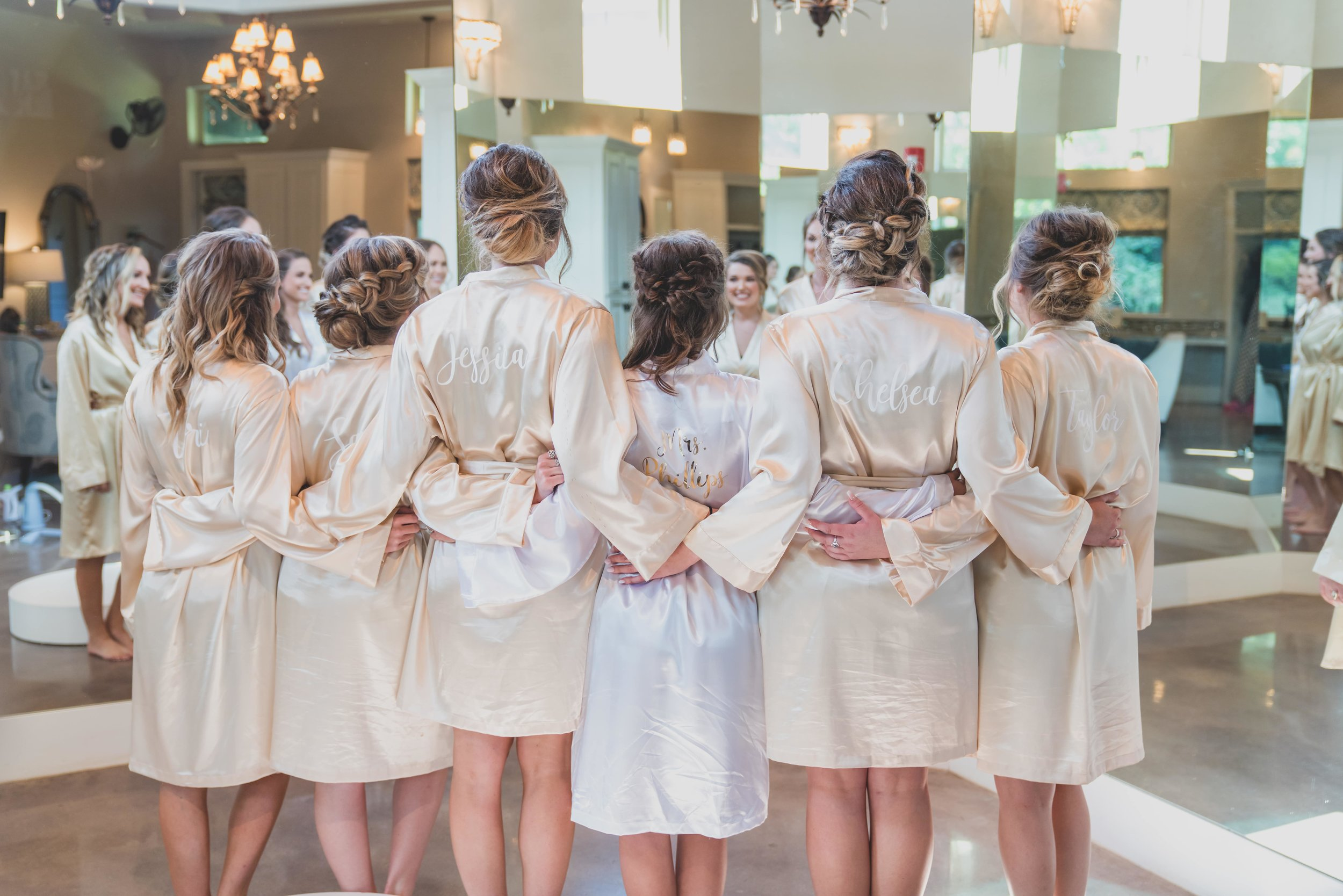 How To Keep Your Bridal Party Informed: A Guide To Keeping Everyone In The Loop - The bridesmaid wearing their bridesmaids robes.