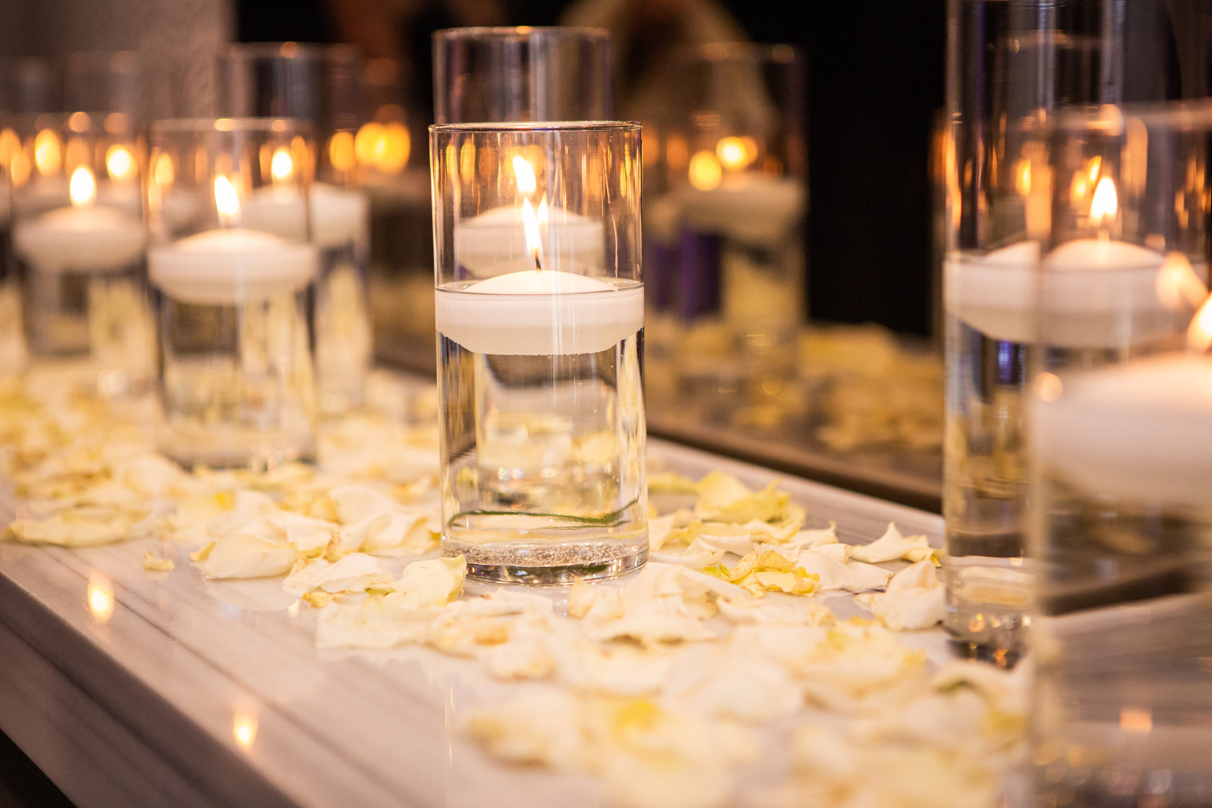 Romantic Wedding Theme Feature - Glendale, CA - Legacy Ballroom - Floating candles sitting on a bed of flower petals to set the atmosphere for the wedding ceremony.