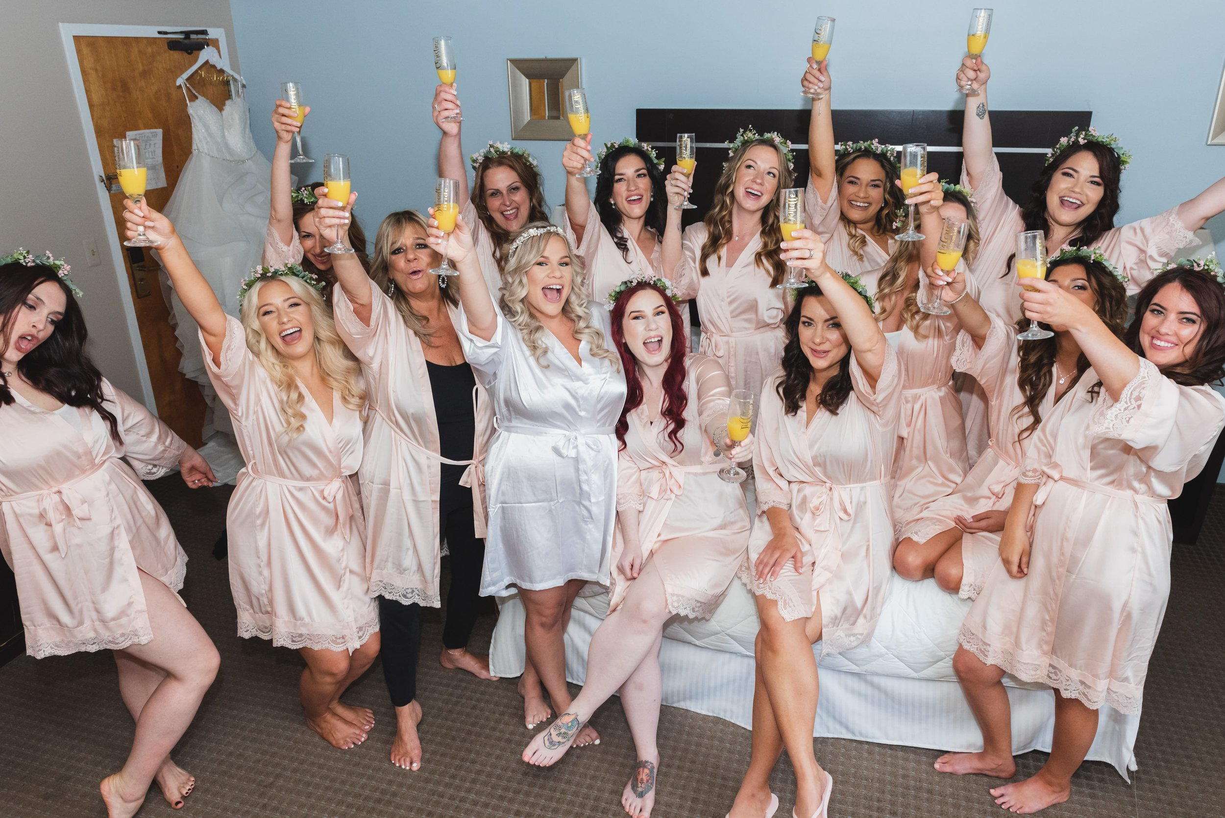 Bride raising a toast with her bridesmaids.