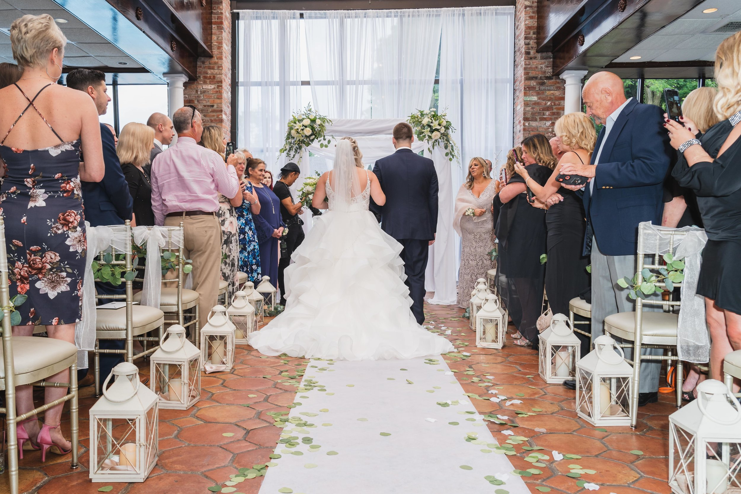 \Bride and groom facing the altar during their wedding ceremony.