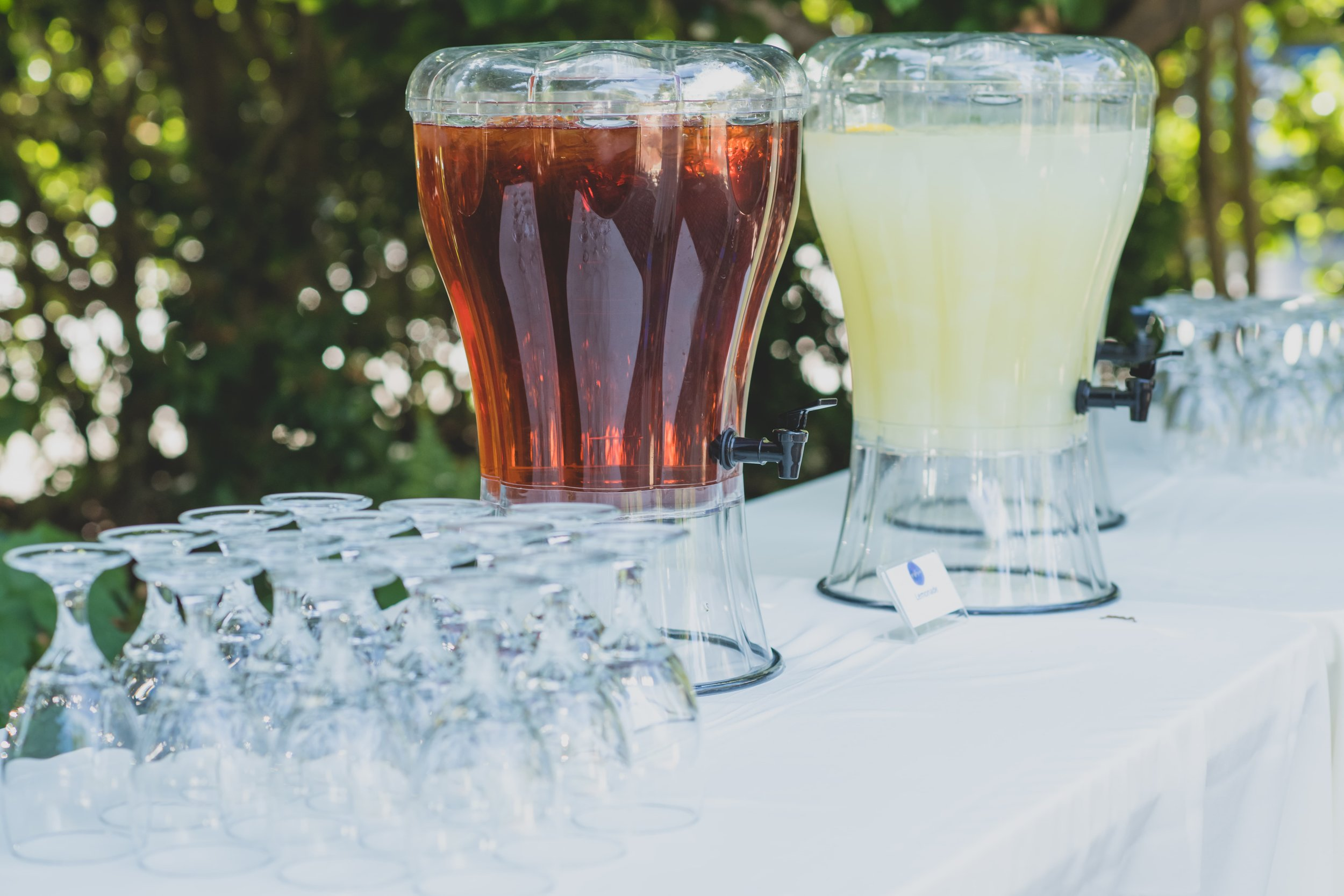 Last Minute Checklist: Things to Know Before Your Outdoor Wedding - A refreshment table setup for an outdoor wedding ceremony.