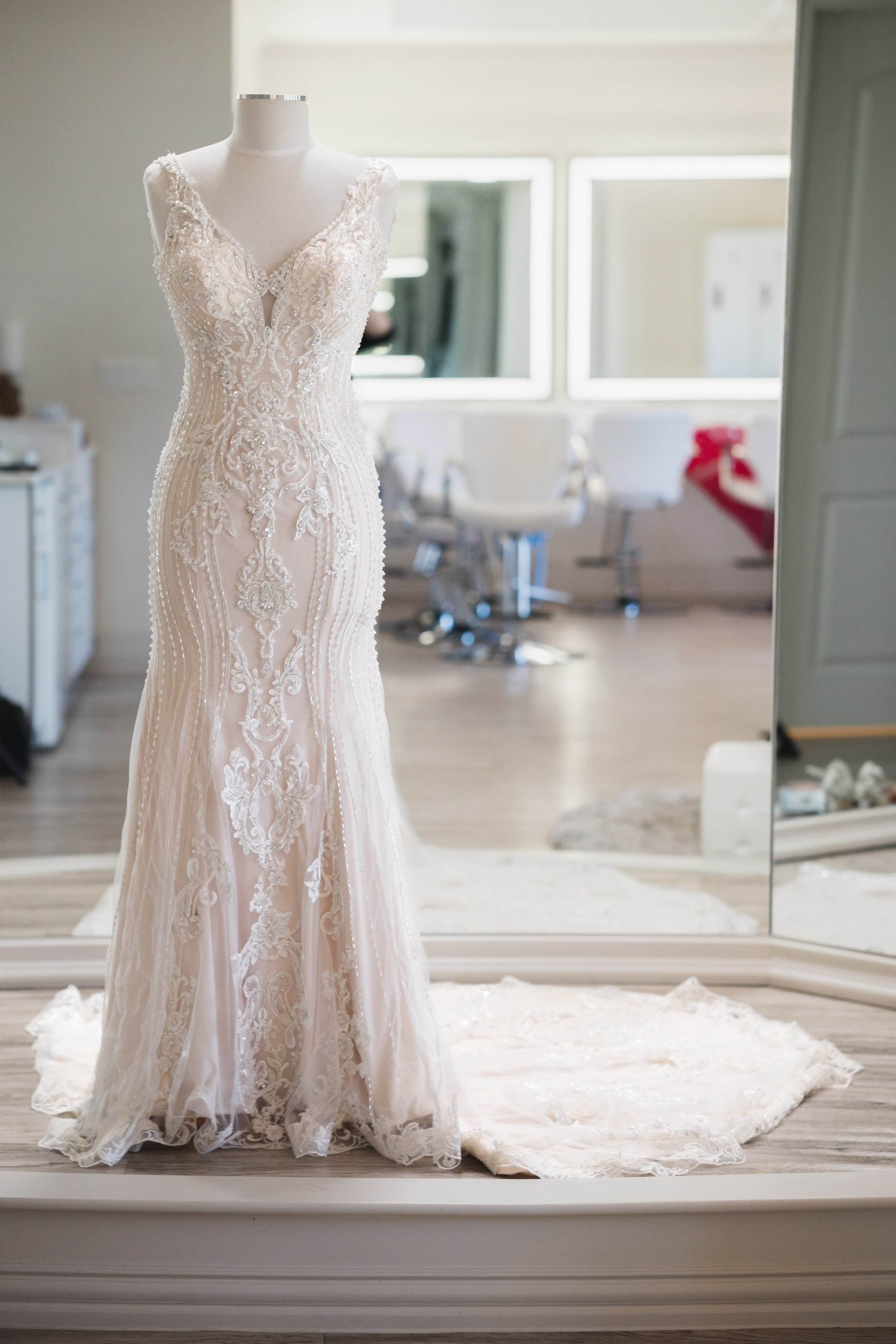 Sleek, modern, off-white wedding dress with embroidery.